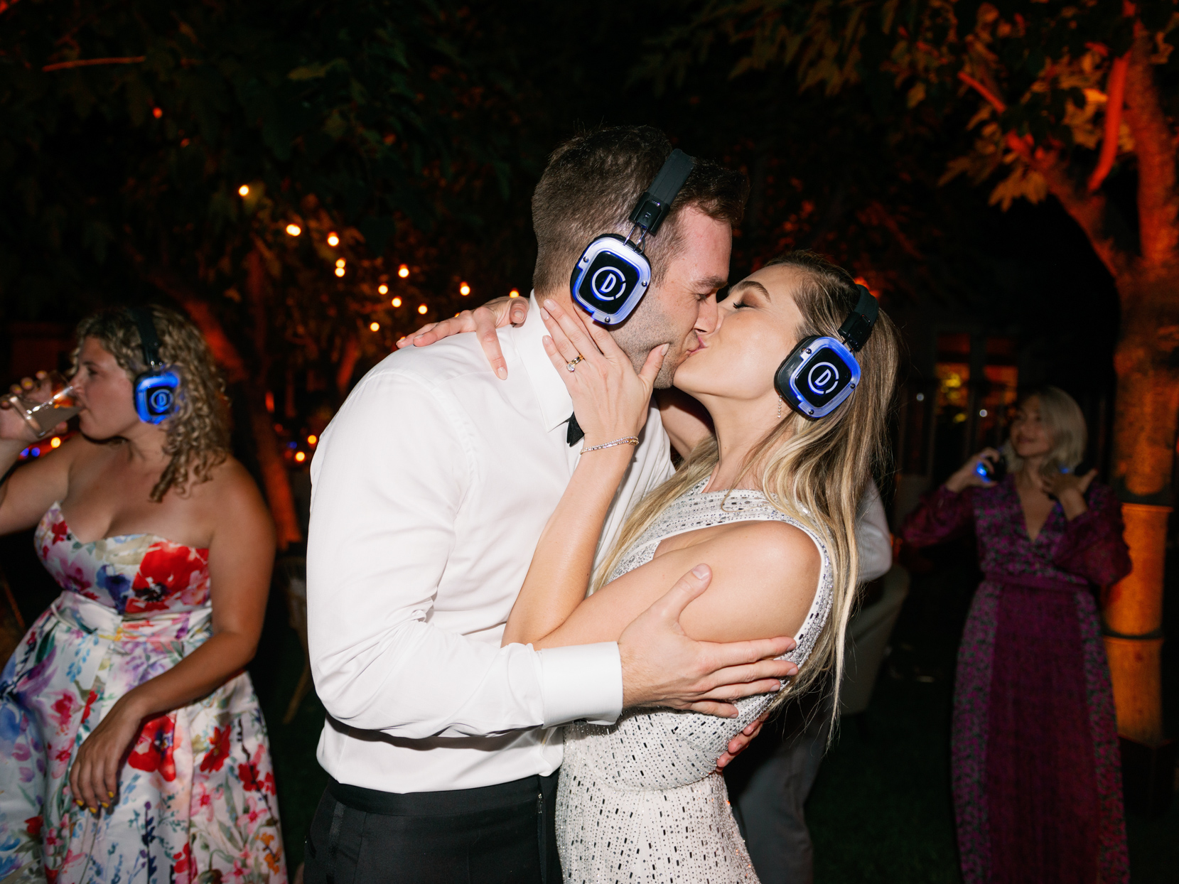 bride and groom kissing during reception silent disco