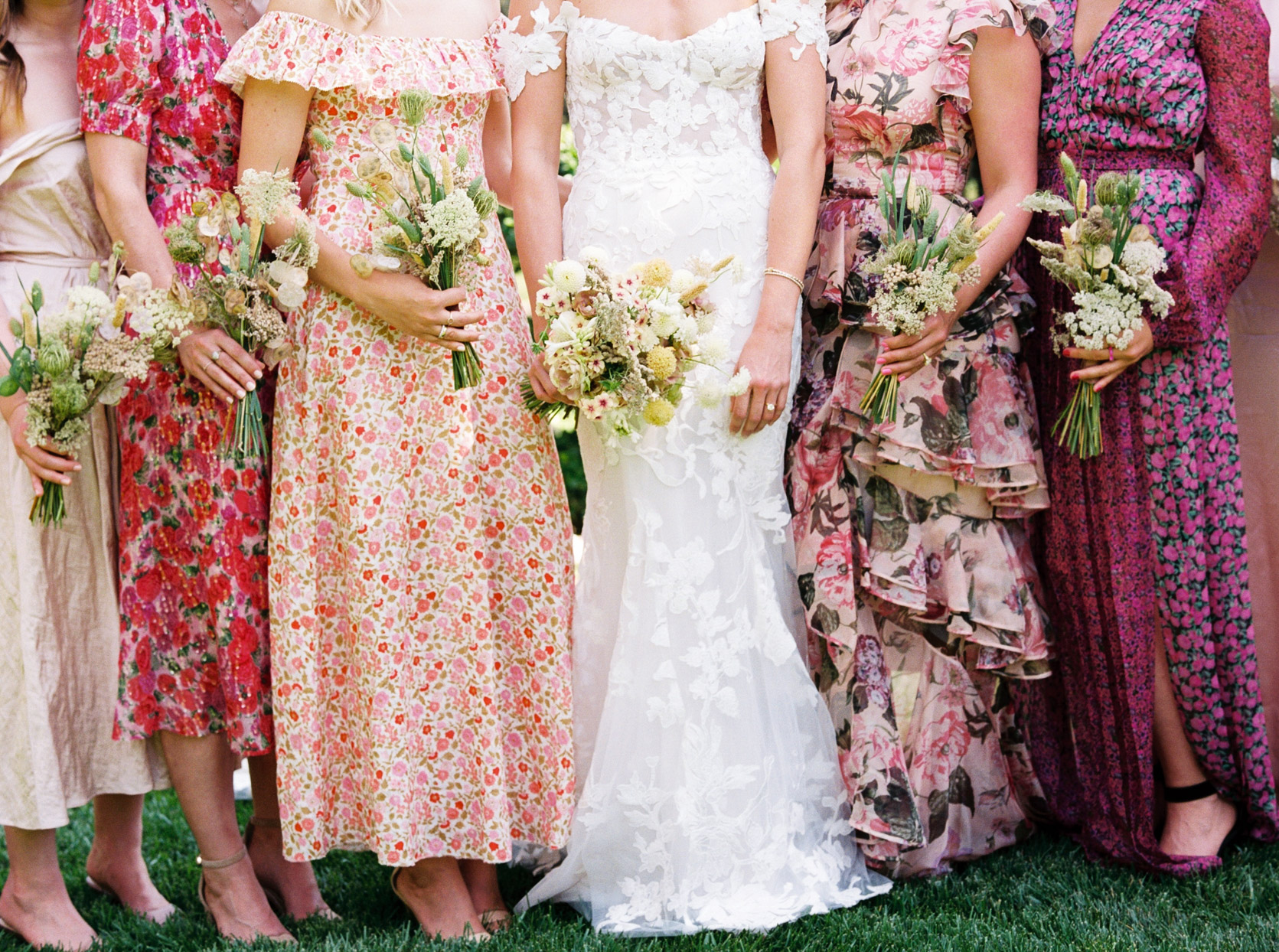 bride and bridesmaids in assorted pink floral patterns