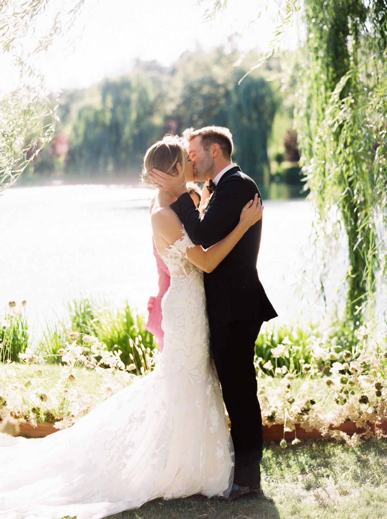 wedding ceremony couple kissing by the water