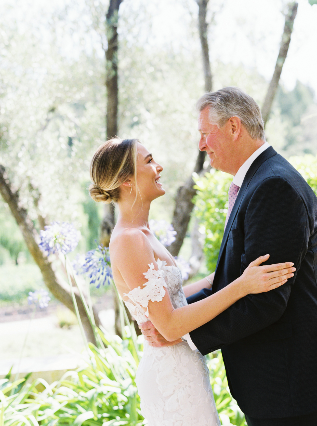 father and bride embracing before wedding