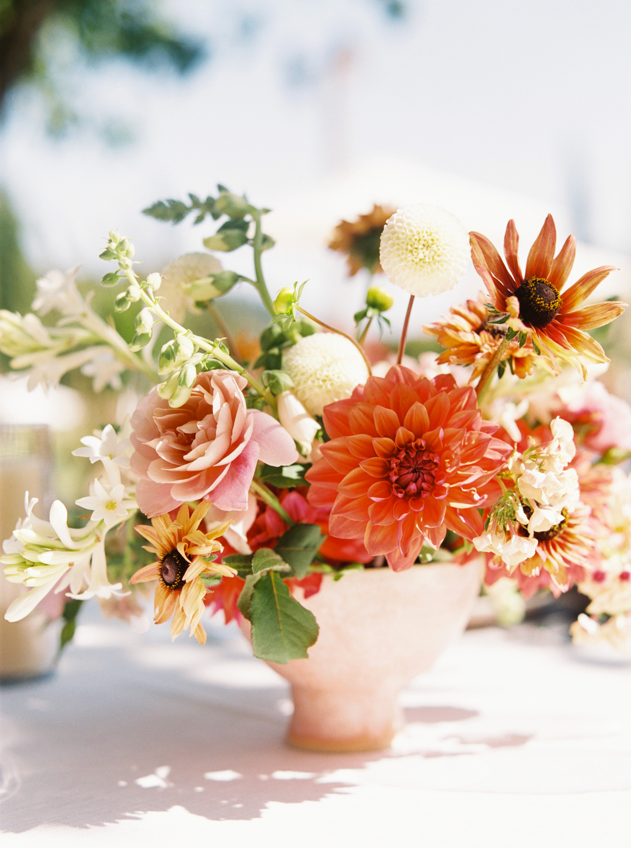 orange and pink wedding reception floral centerpieces
