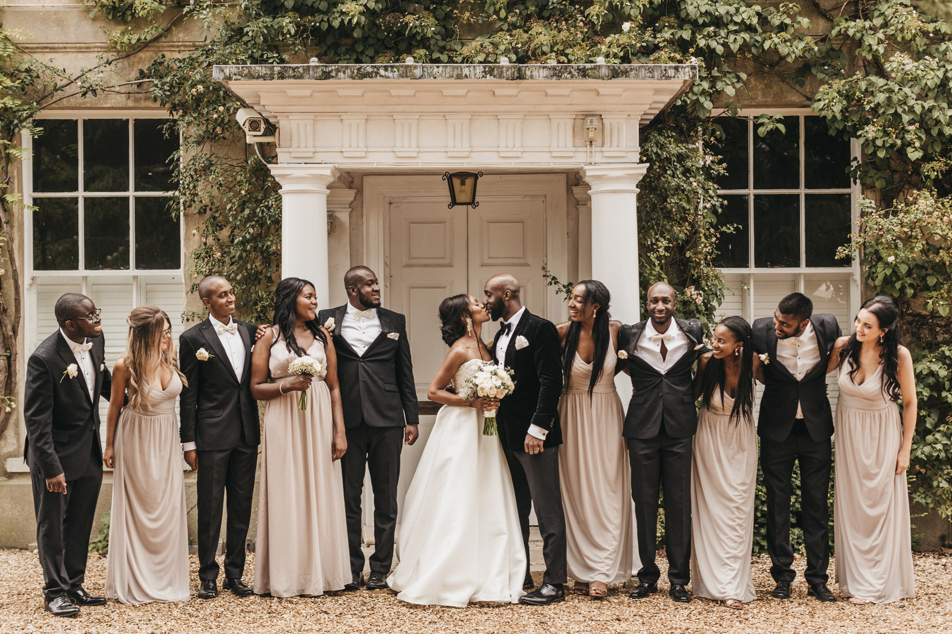 wedding party tuxedos cream colored gowns