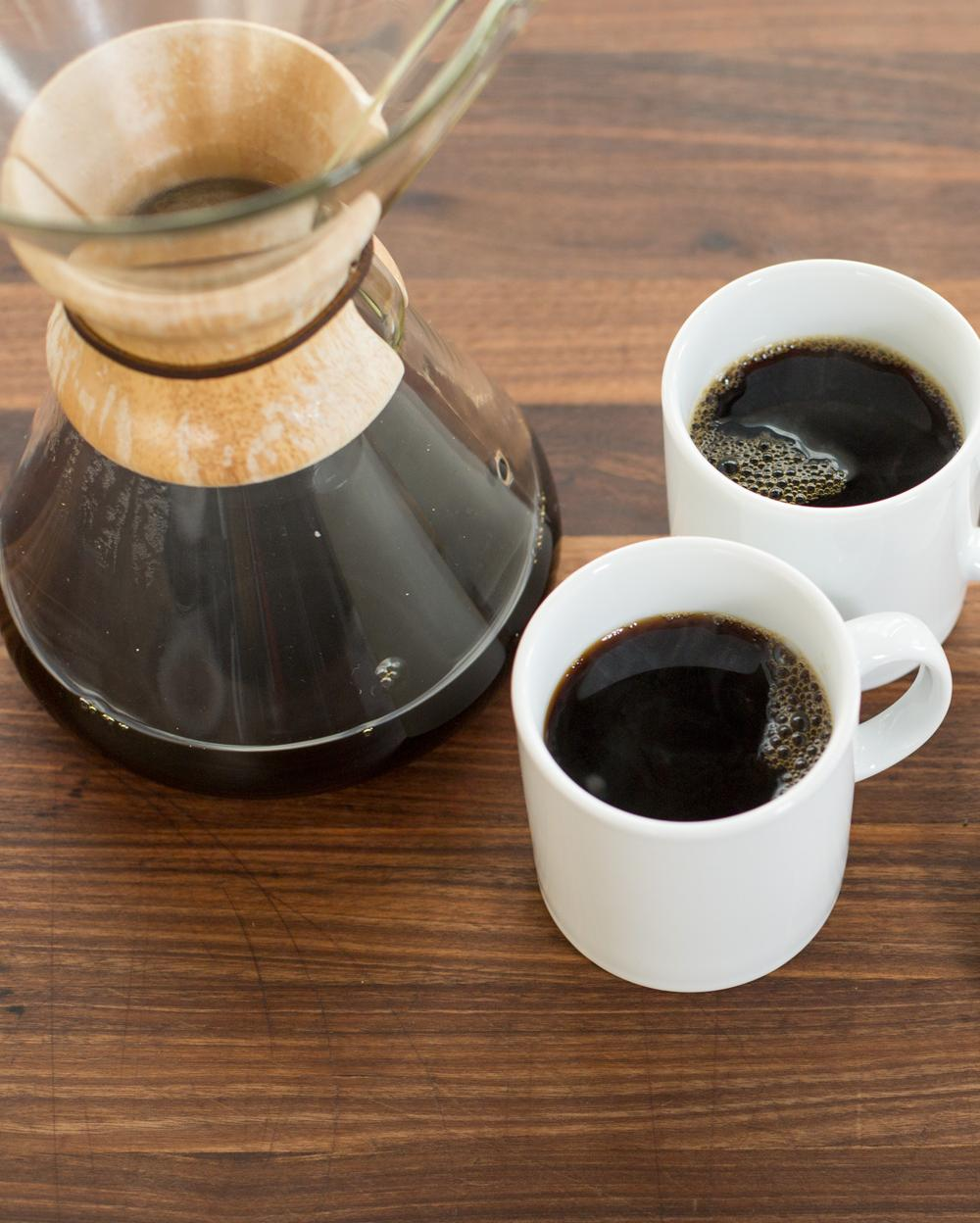 two cups of black coffee and a Chemex