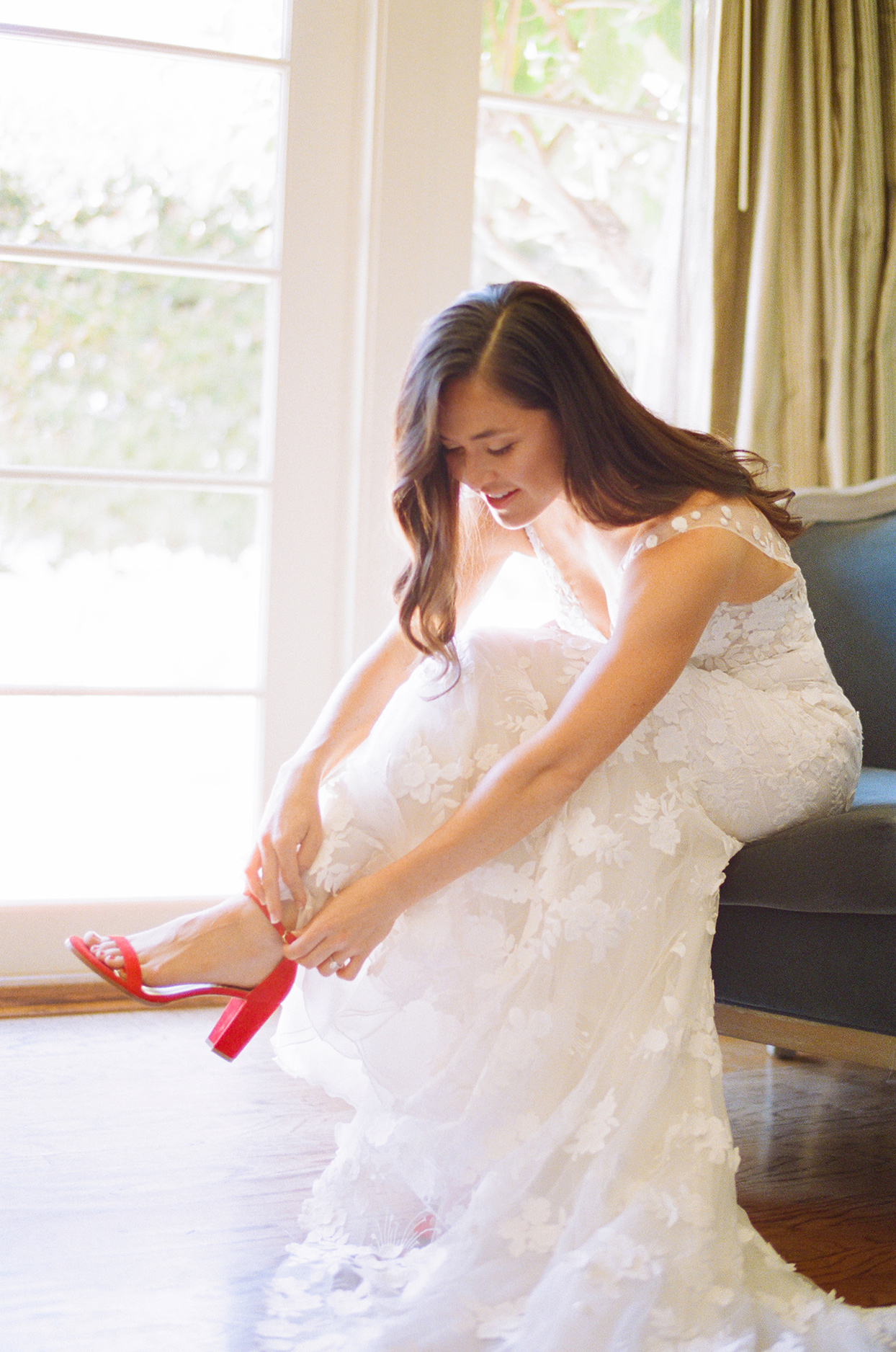 Bride in Mira Zwillinger gown with lace fit-and-flare with hand-embroidered flowers and red open-toe heels from Stuart Weitzman