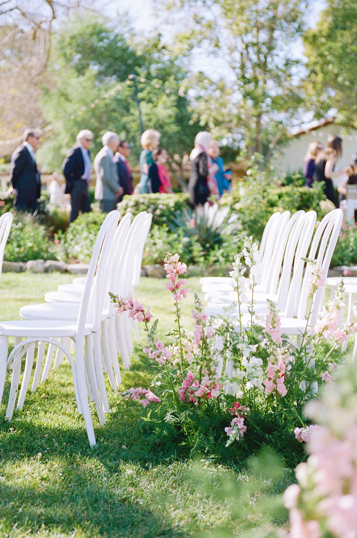Chairs set up for an outdoor wedding ceremony