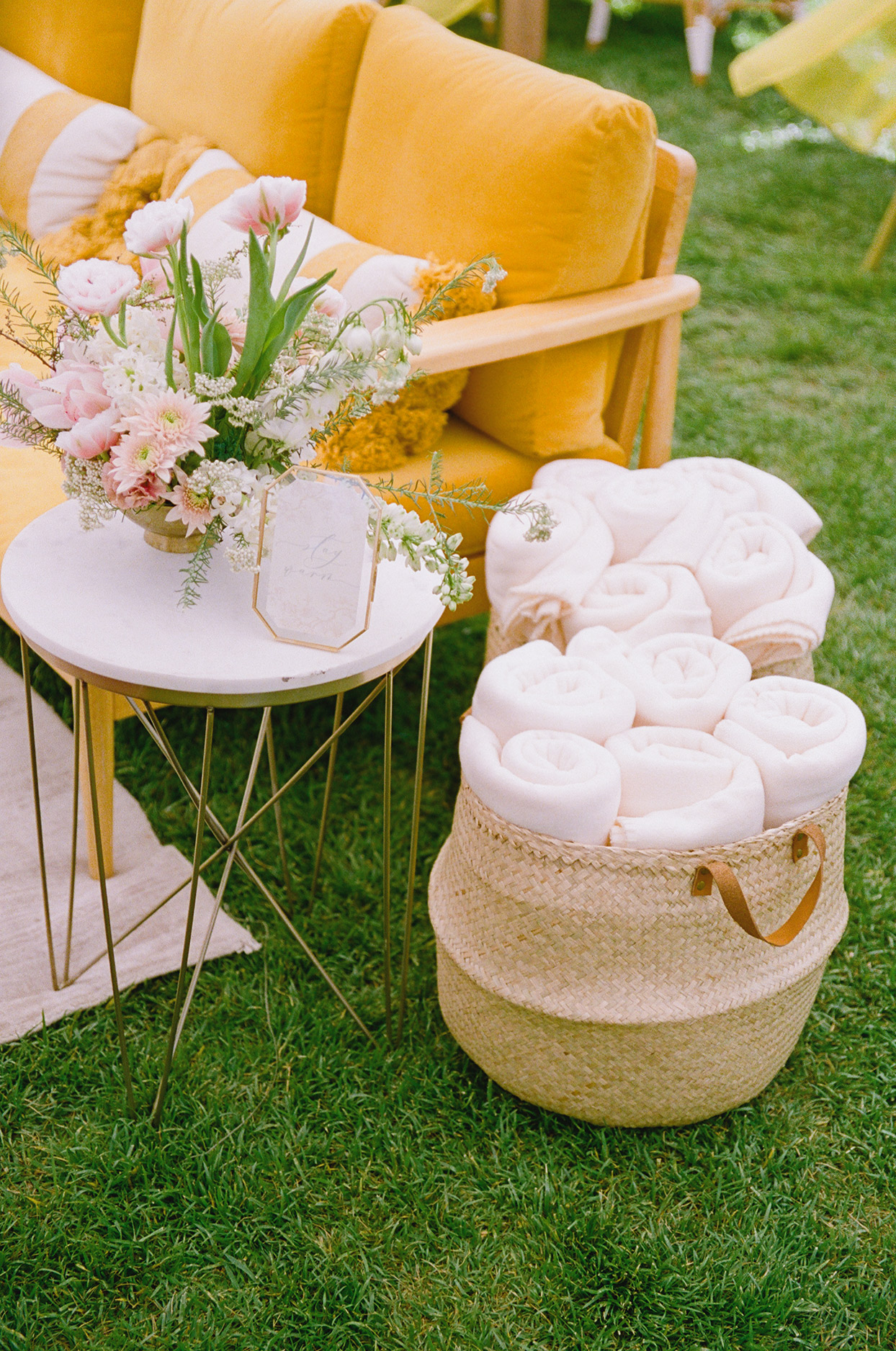 blankets in lounge area for outdoor wedding