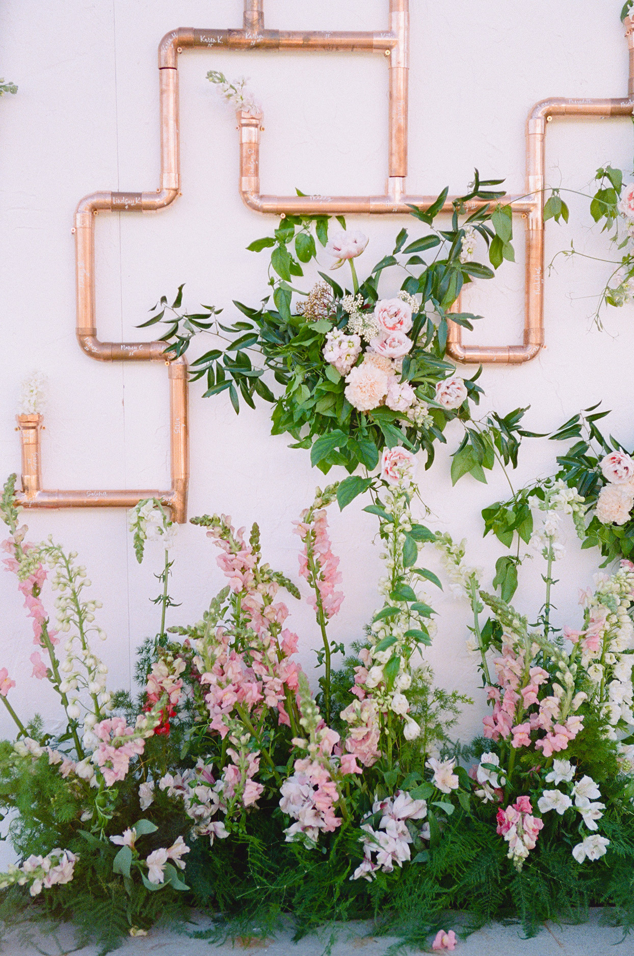 copper pipe seating chart with flowers