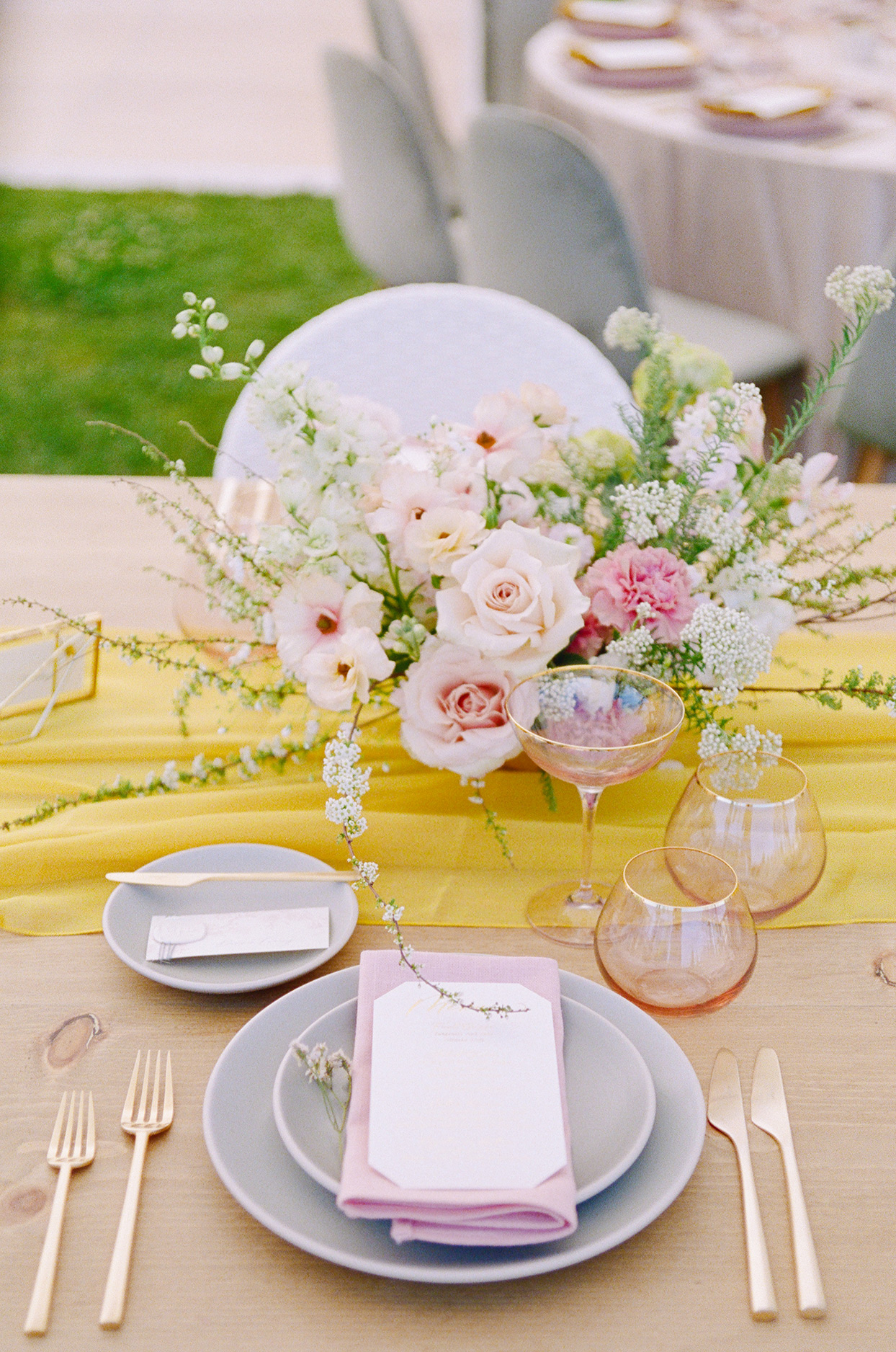 wedding place settings with lilac plates with gold flatware and blush-colored glassware