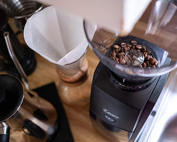 coffee grinder with beans and chemex coffee maker