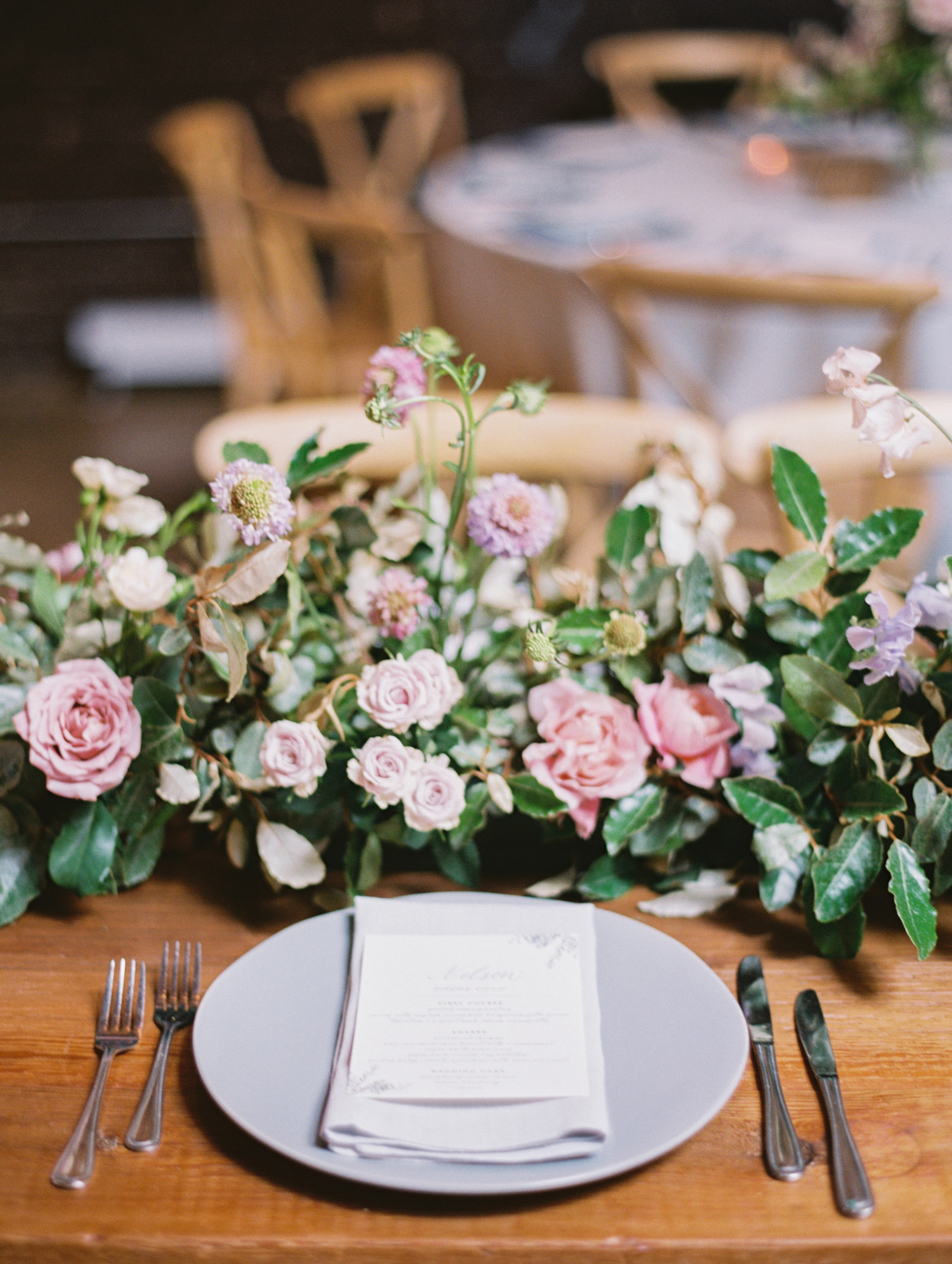 place setting and pink and purple floral centerpiece