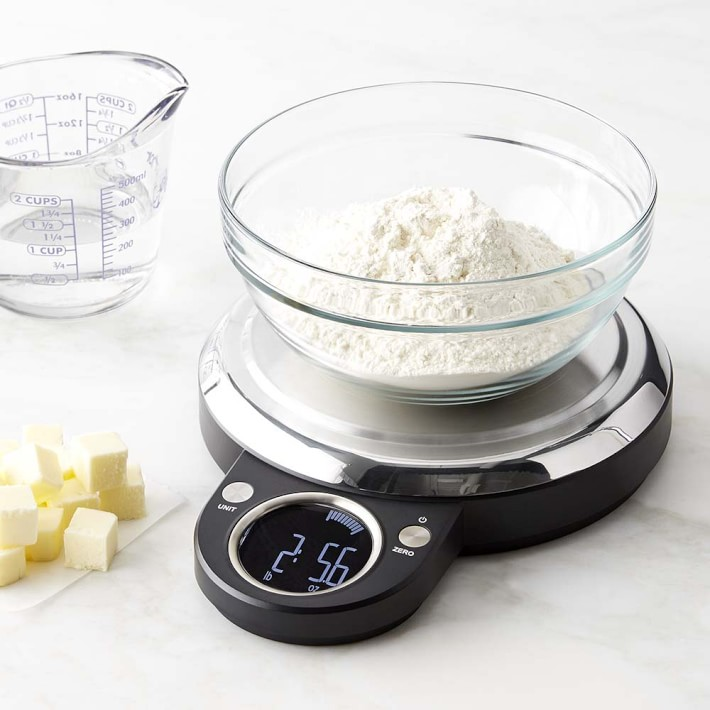 kitchen scale measuring flour on marble surface