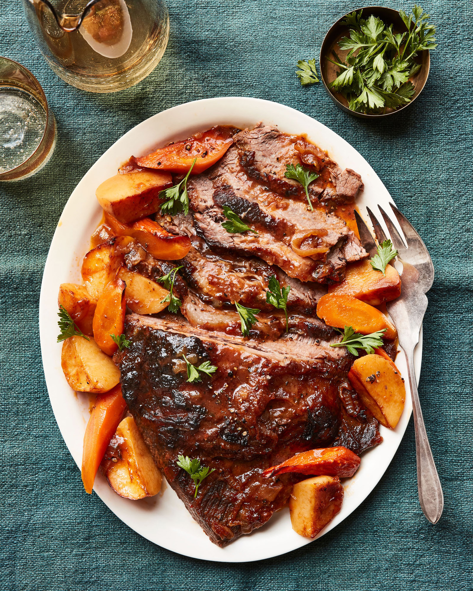 sweet-and-sour brisket on platter with carrots and potatoes