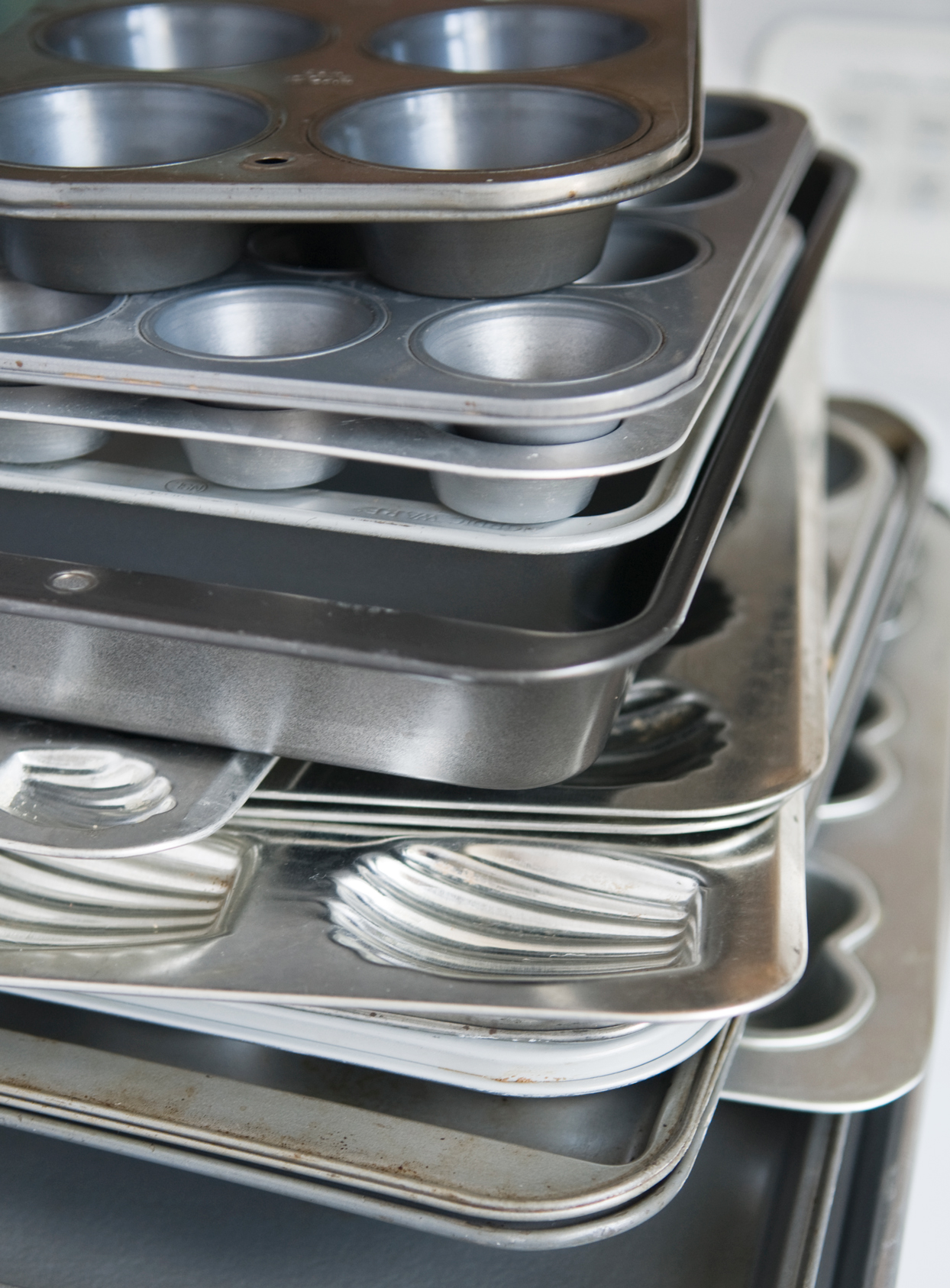 stack of aluminum pans for cookies, muffins, and cupcakes