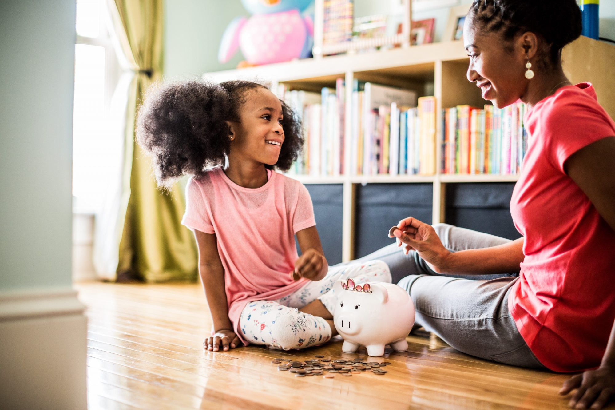mother and daughter counting piggy bank money