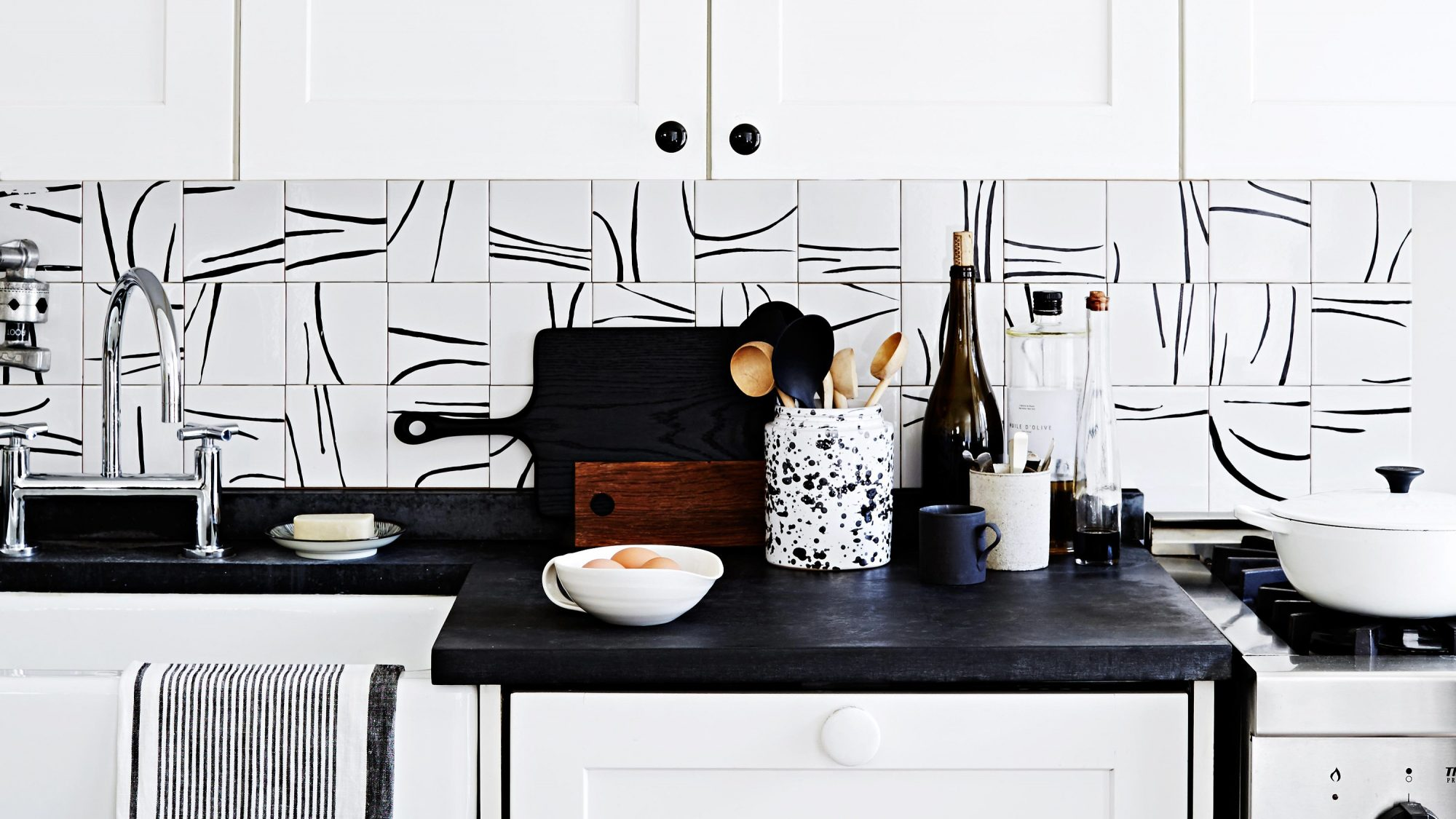 various black and white patterns themed kitchen decor and backsplash