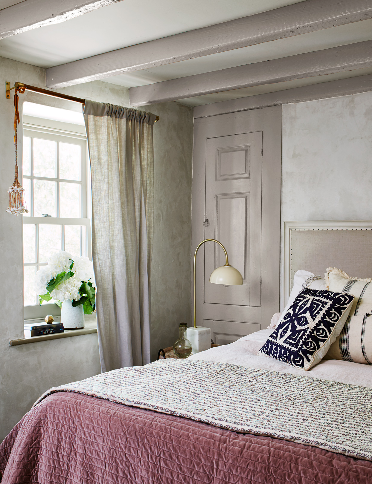a classic and charming bedroom in Hill's home