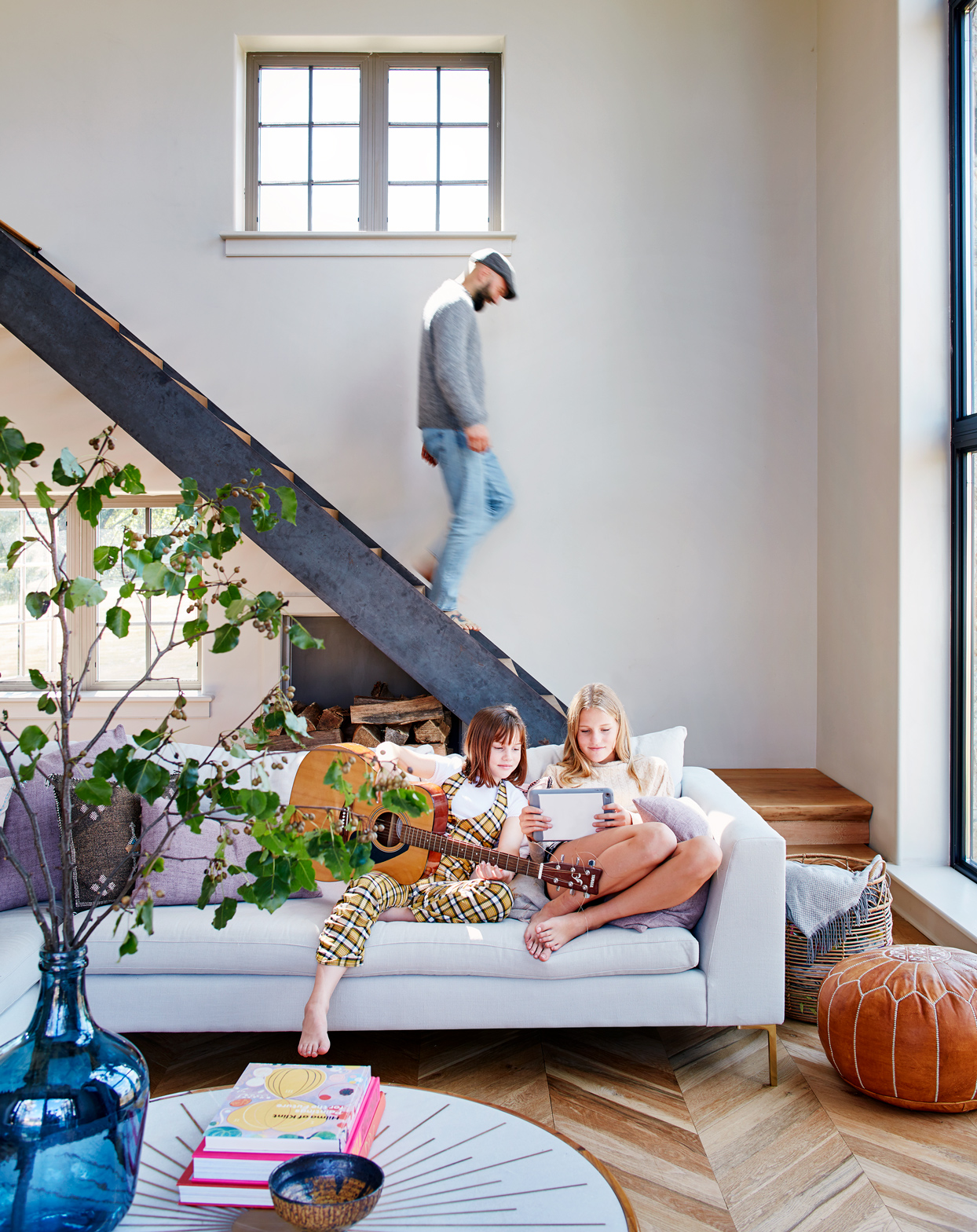 Hill's husband and daughters in the living room