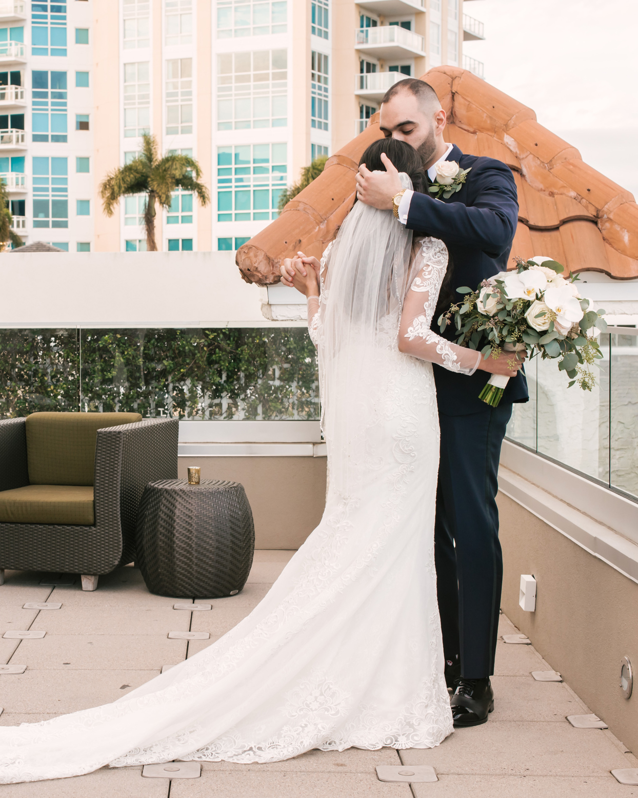 first look embrace on roof with hotel view
