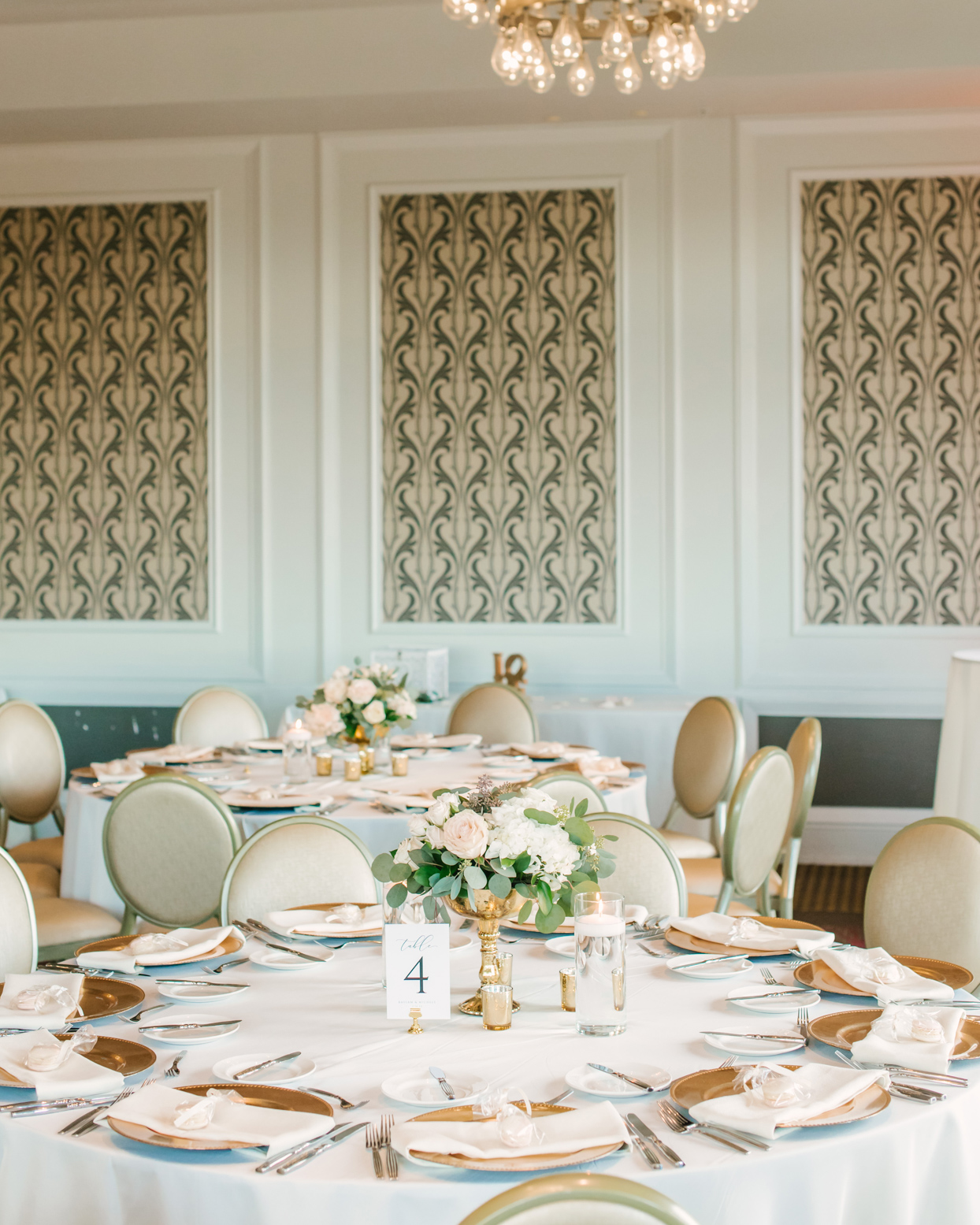 elegant white and gold wedding reception tables