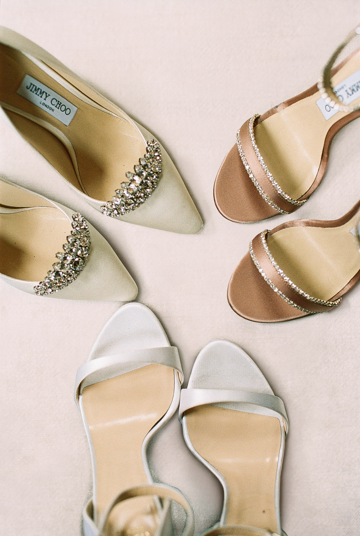 bride's gold, silver, and bronze wedding shoes