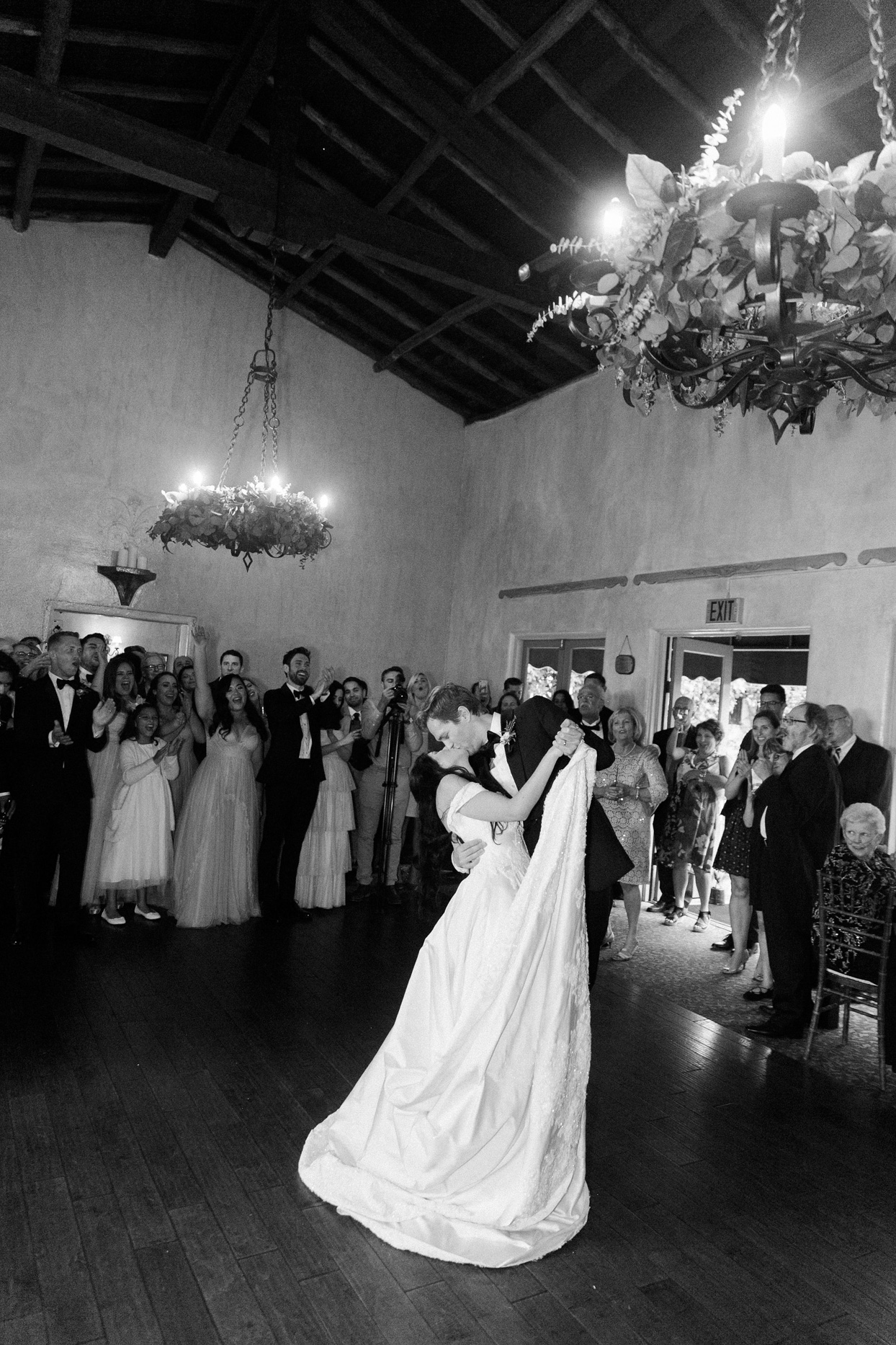 wedding couple first dance dip and kiss