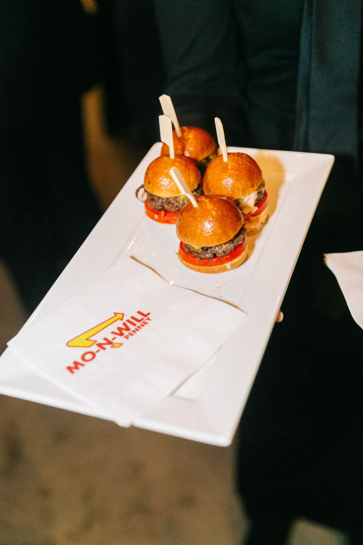 in-n-out burgers on white tray at wedding reception
