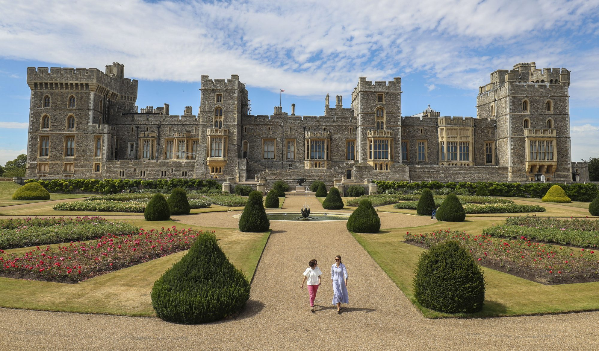Windsor Castle's East Terrace Garden with people walking past the flowers and fountain