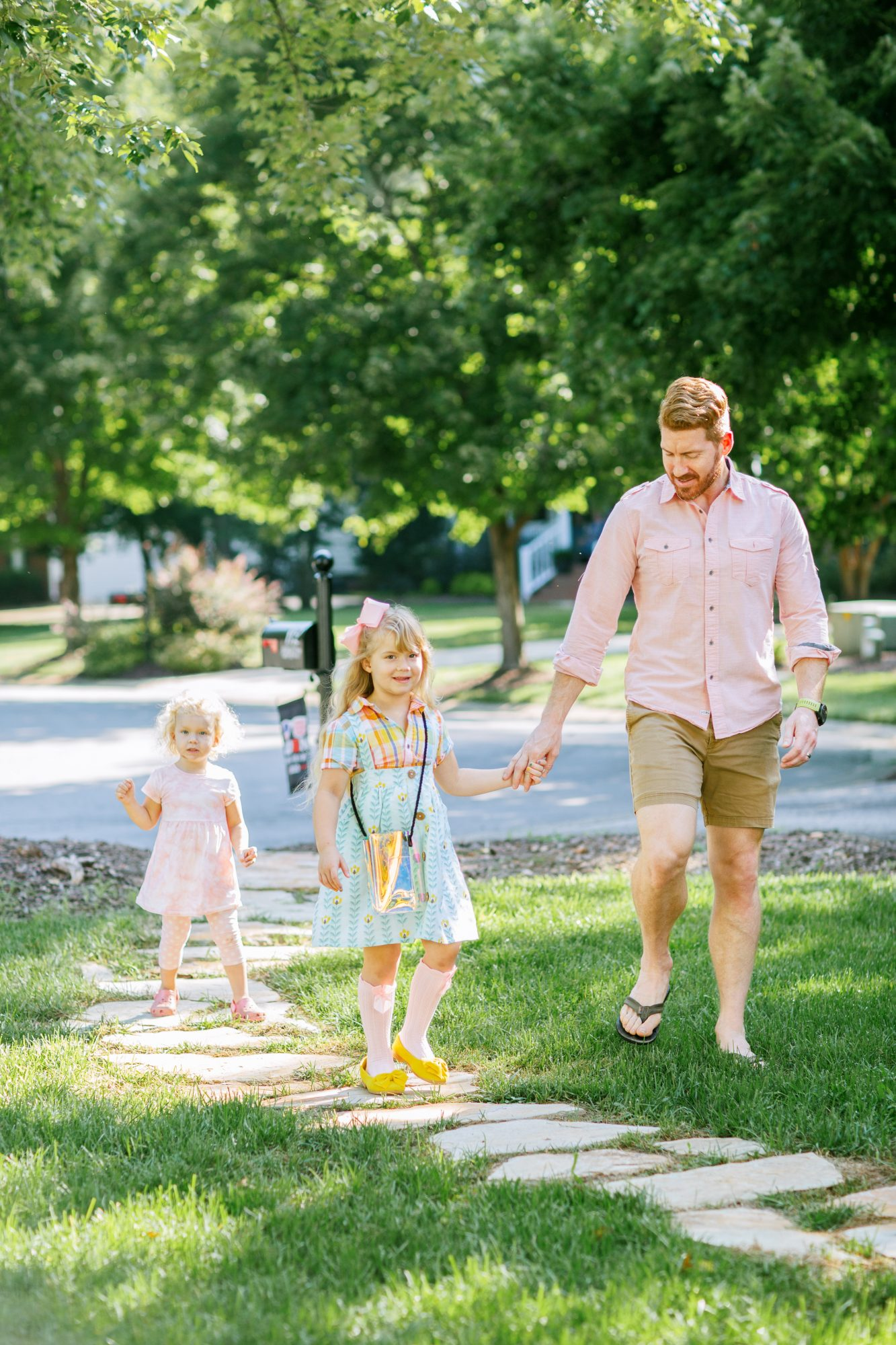 daughter holding father's hand walking