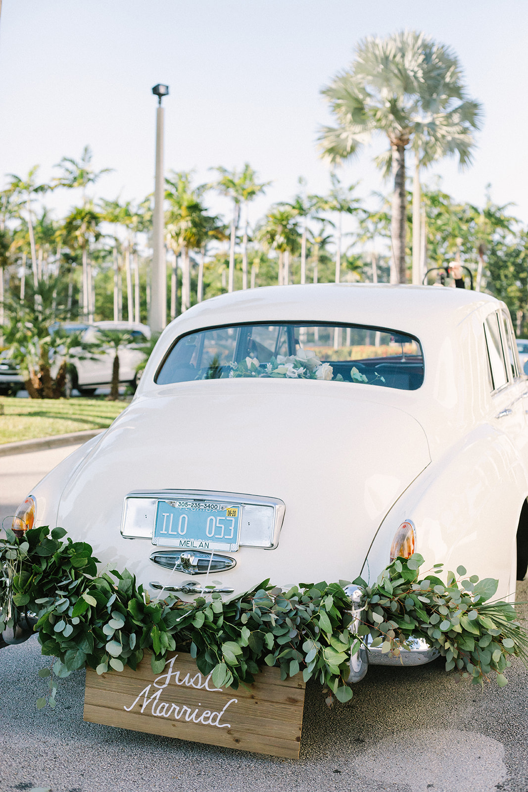 white vintage car with just married sign