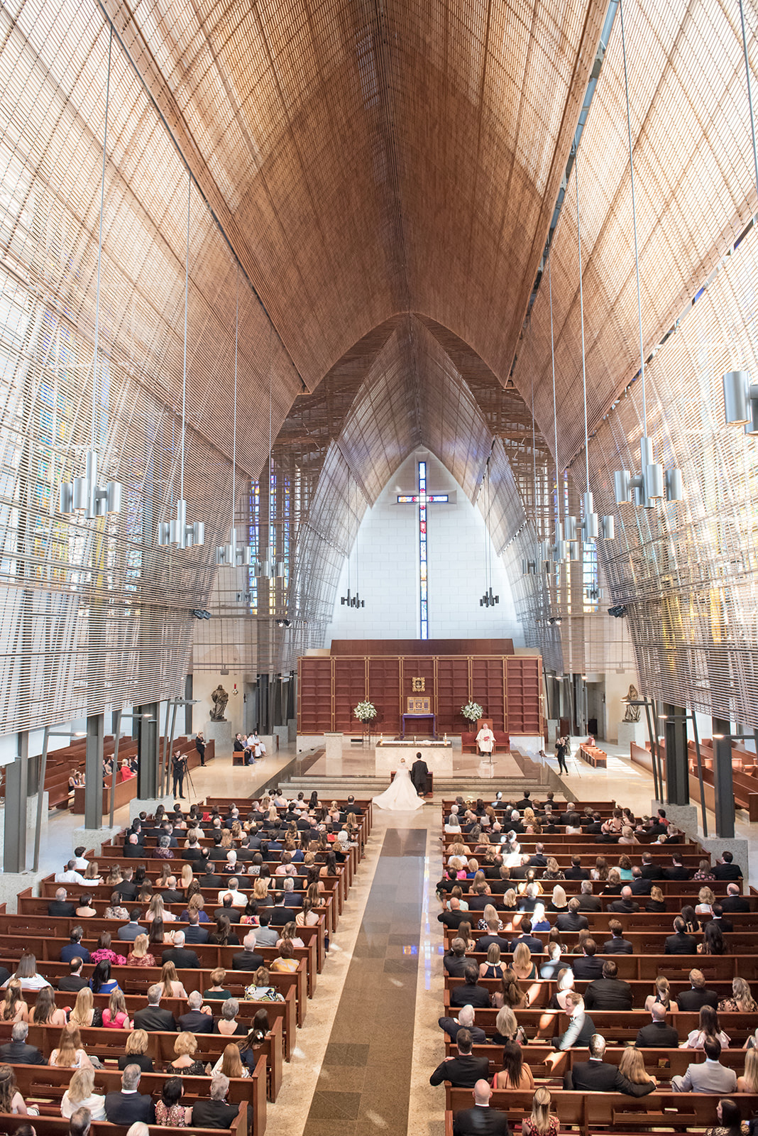 large church filled with wedding guests