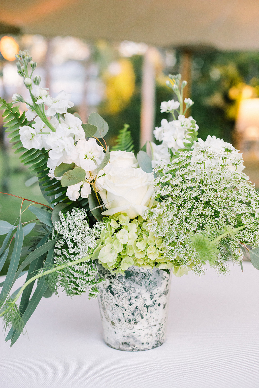 white floral and greenery centerpieces
