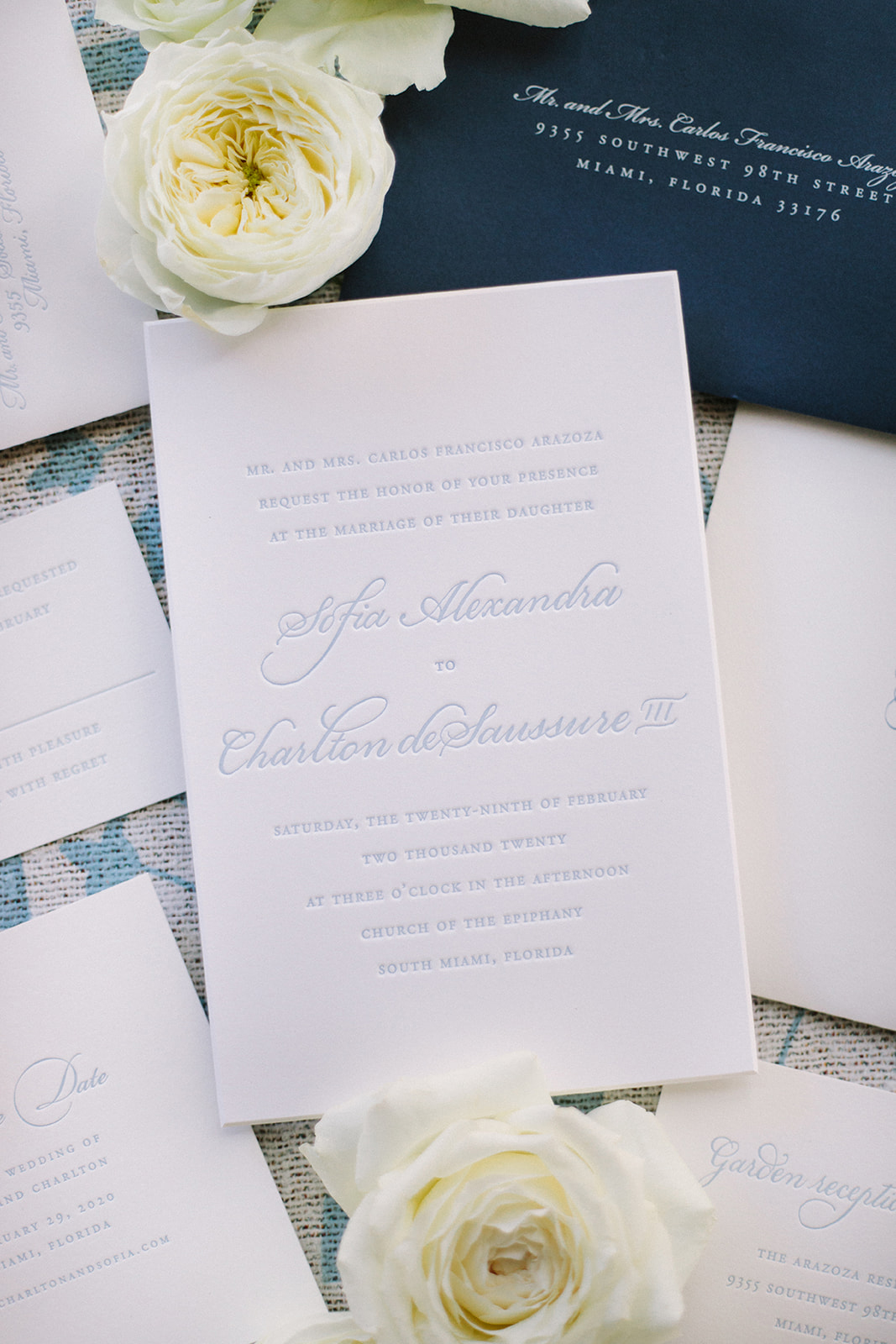 white and blue wedding invitation suite