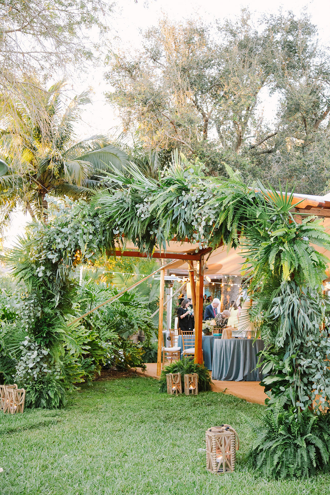 large greenery cover wedding tent arch
