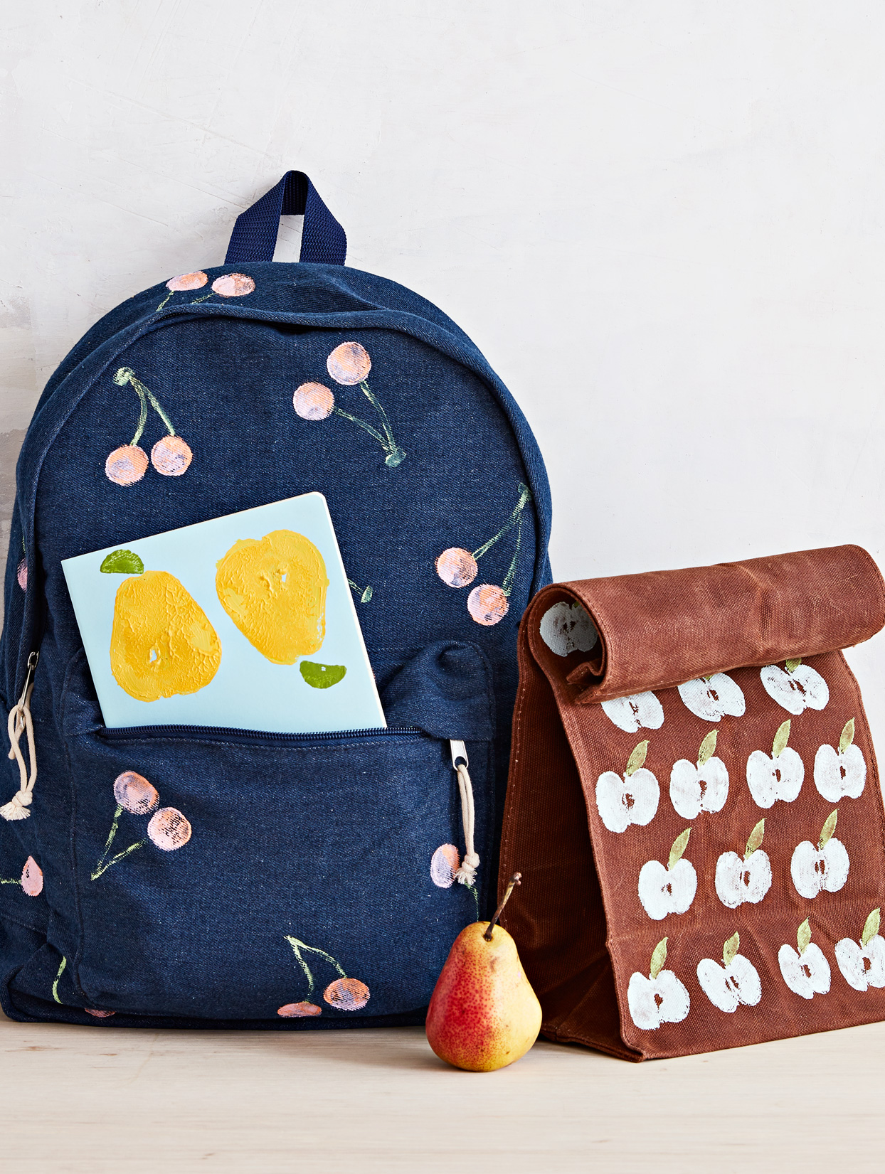 school supplies personalized with fruit and veggie stamps