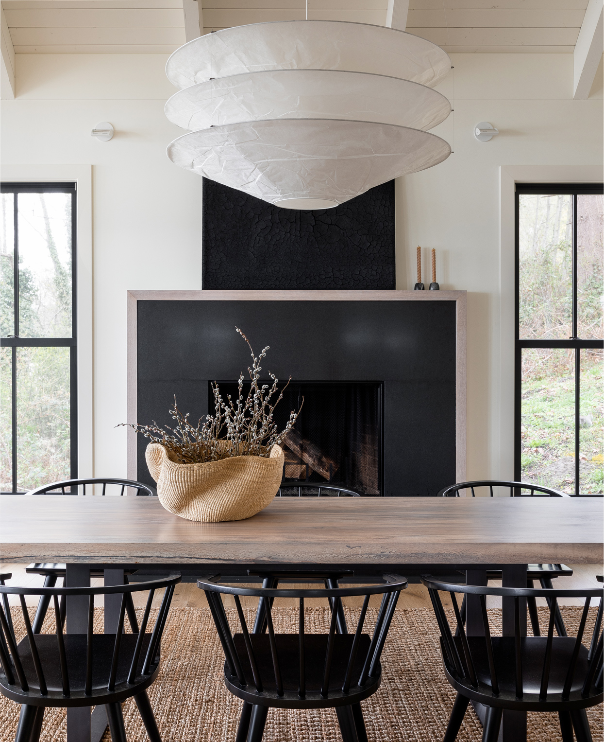 neutral-colored dining room with black fireplace