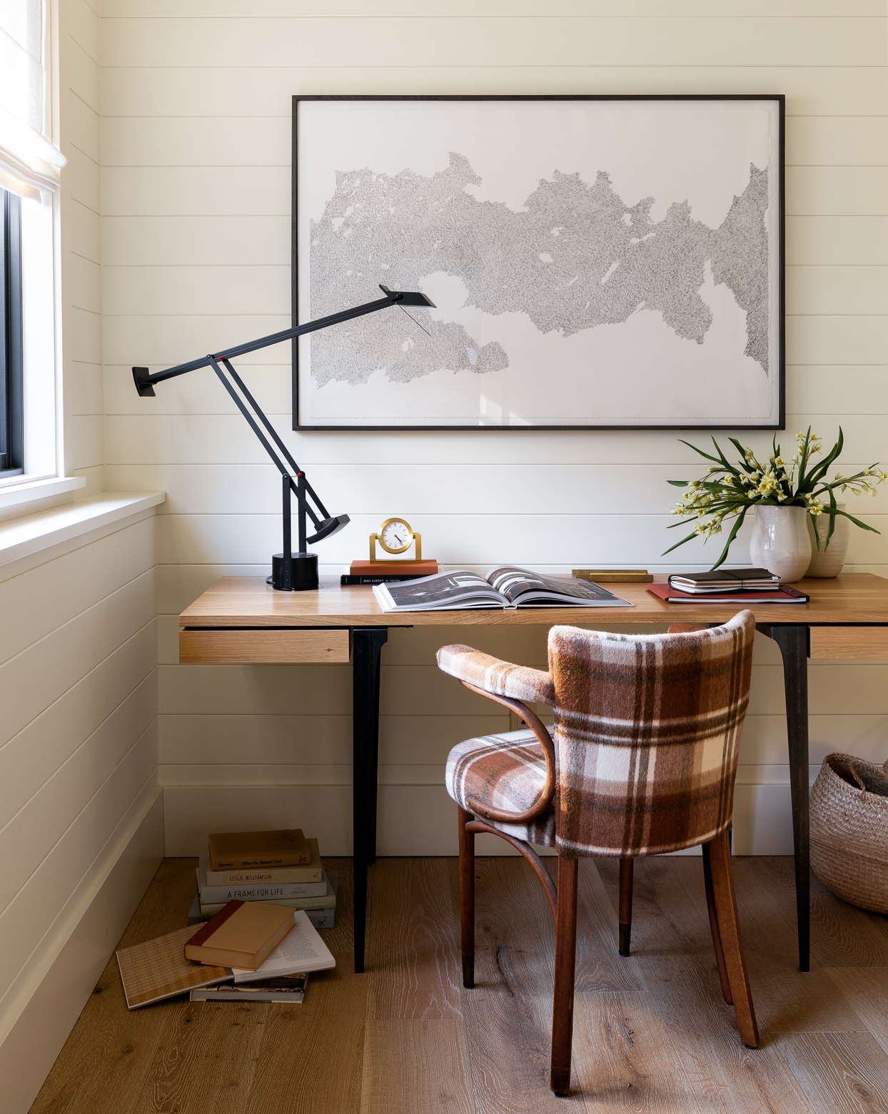 plaid chair at wooden desk in home office