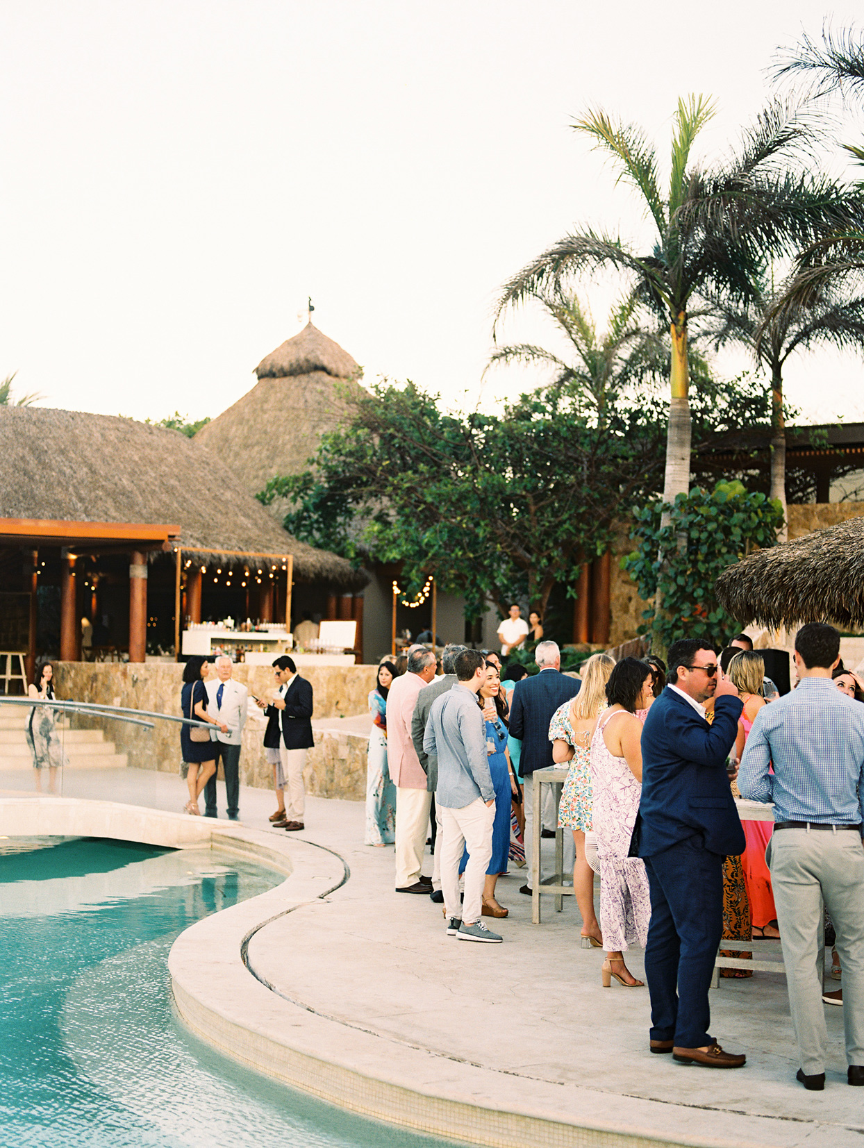 guests gathered outside at rehearsal dinner
