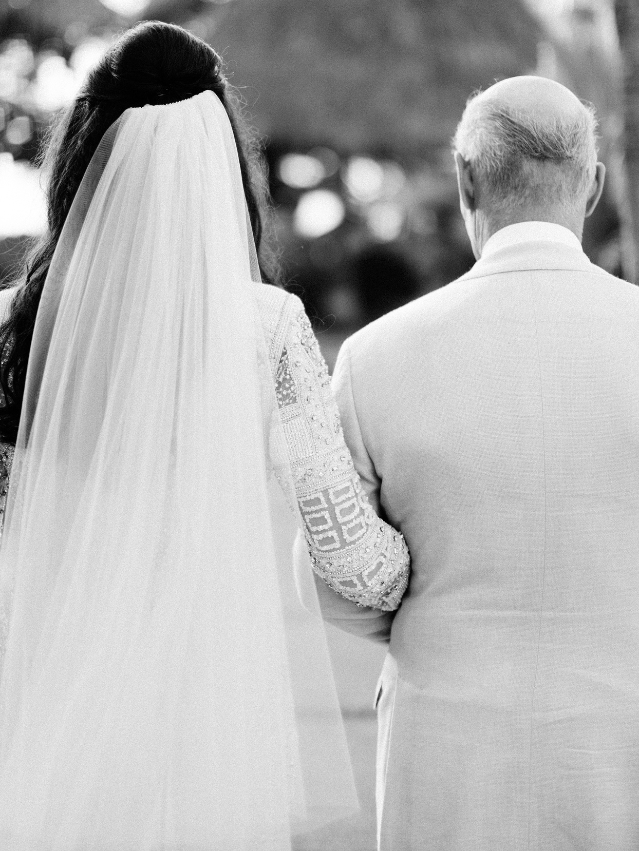 father of the bride walking bride down wedding processional aisle
