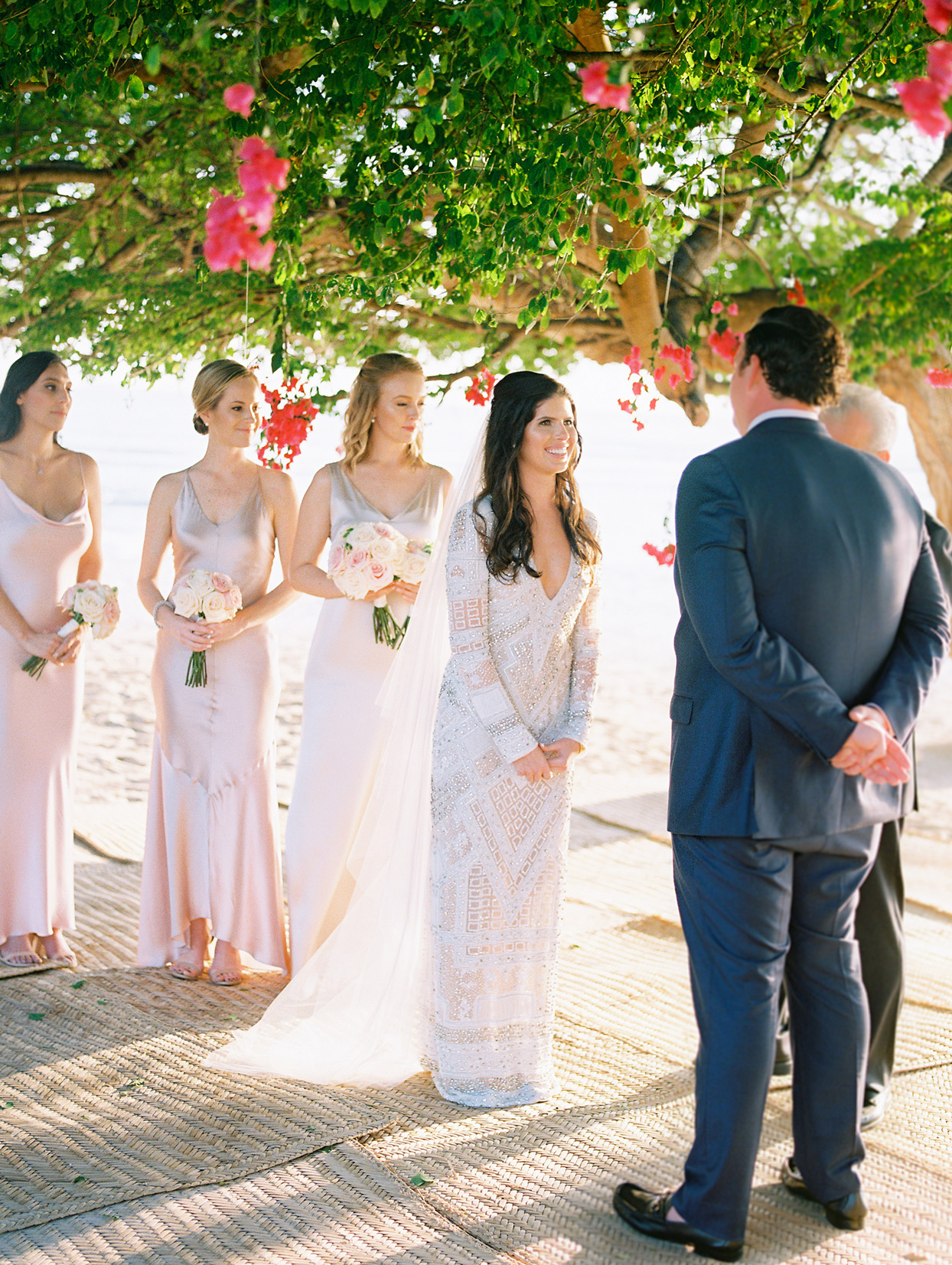 bride and groom exchanging wedding vows at outdoor ceremony