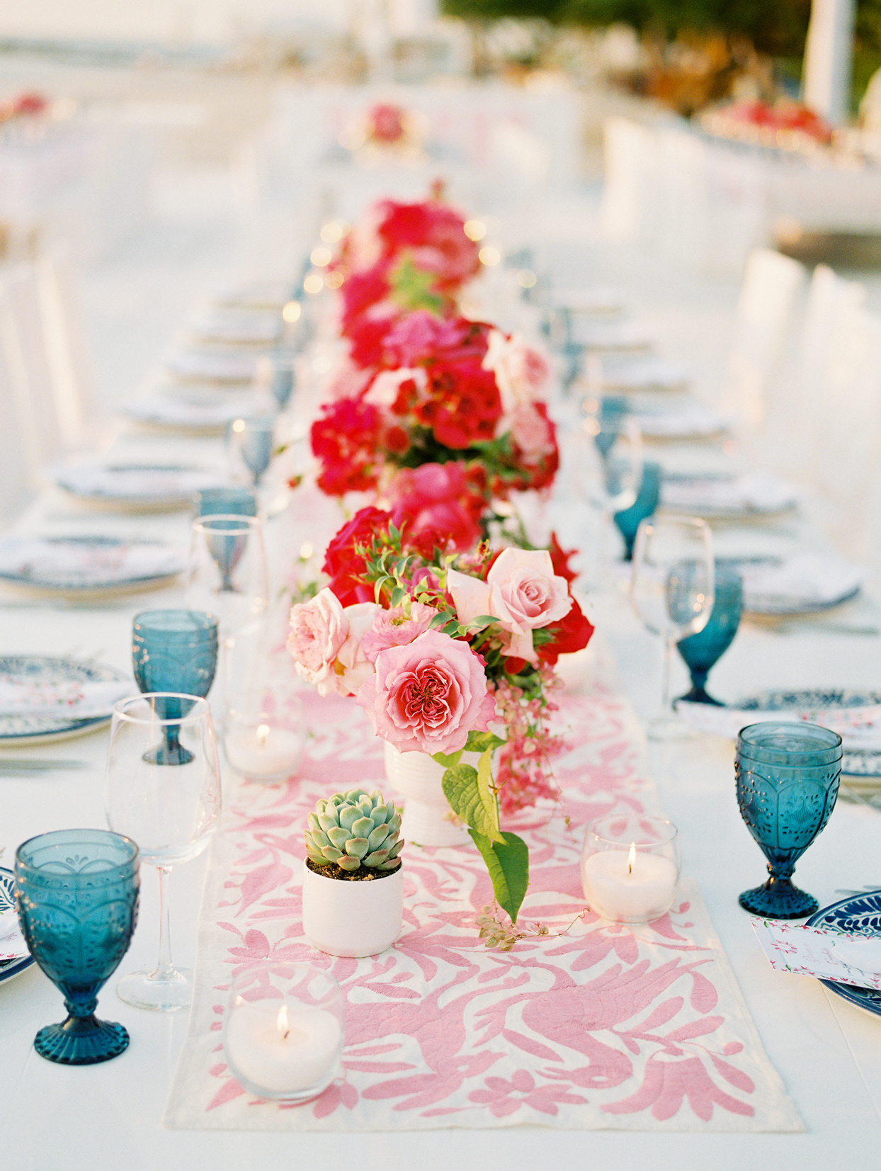red and pink floral wedding reception table centerpieces