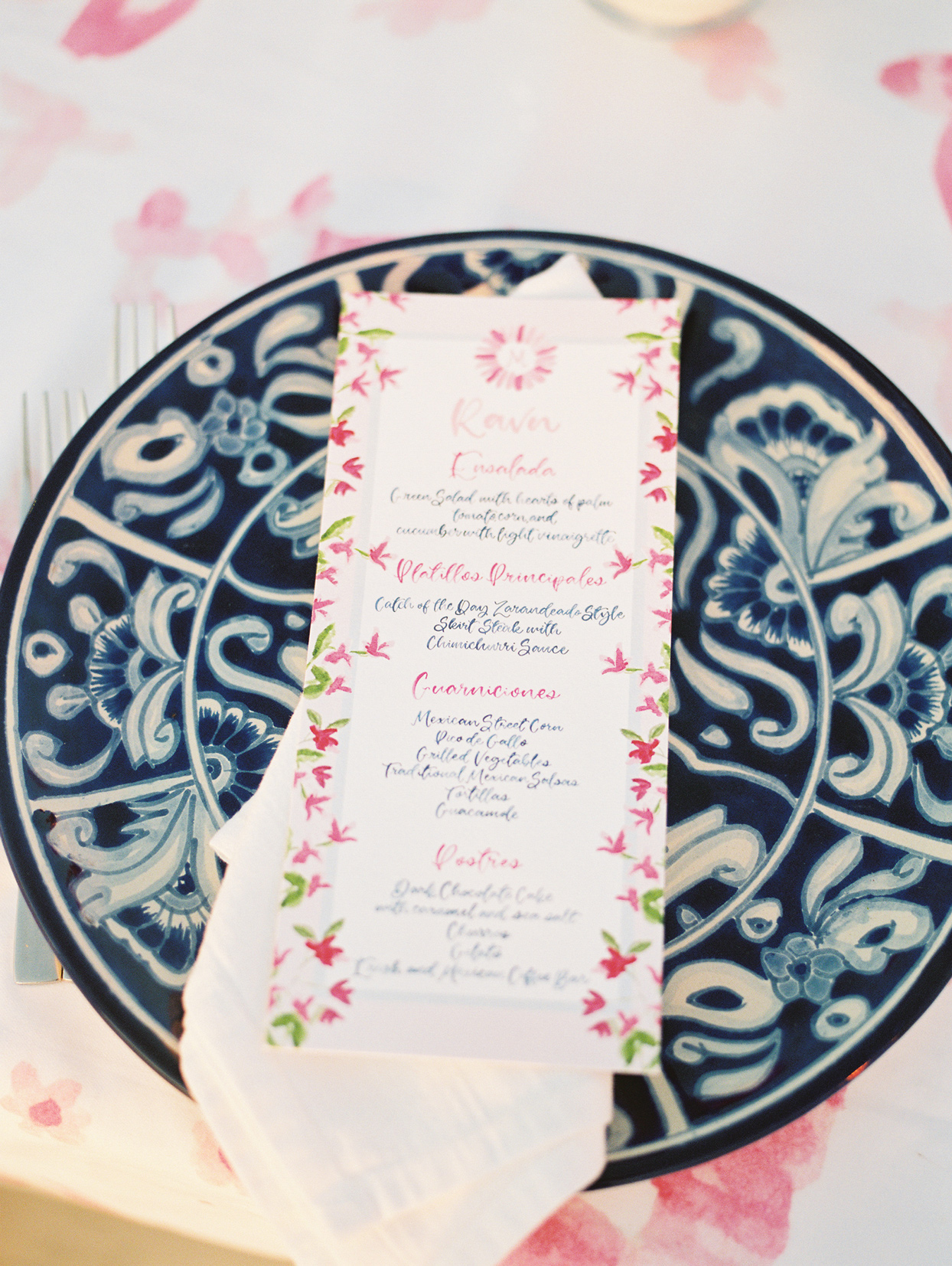 pink and green reception menu on blue and white design place setting