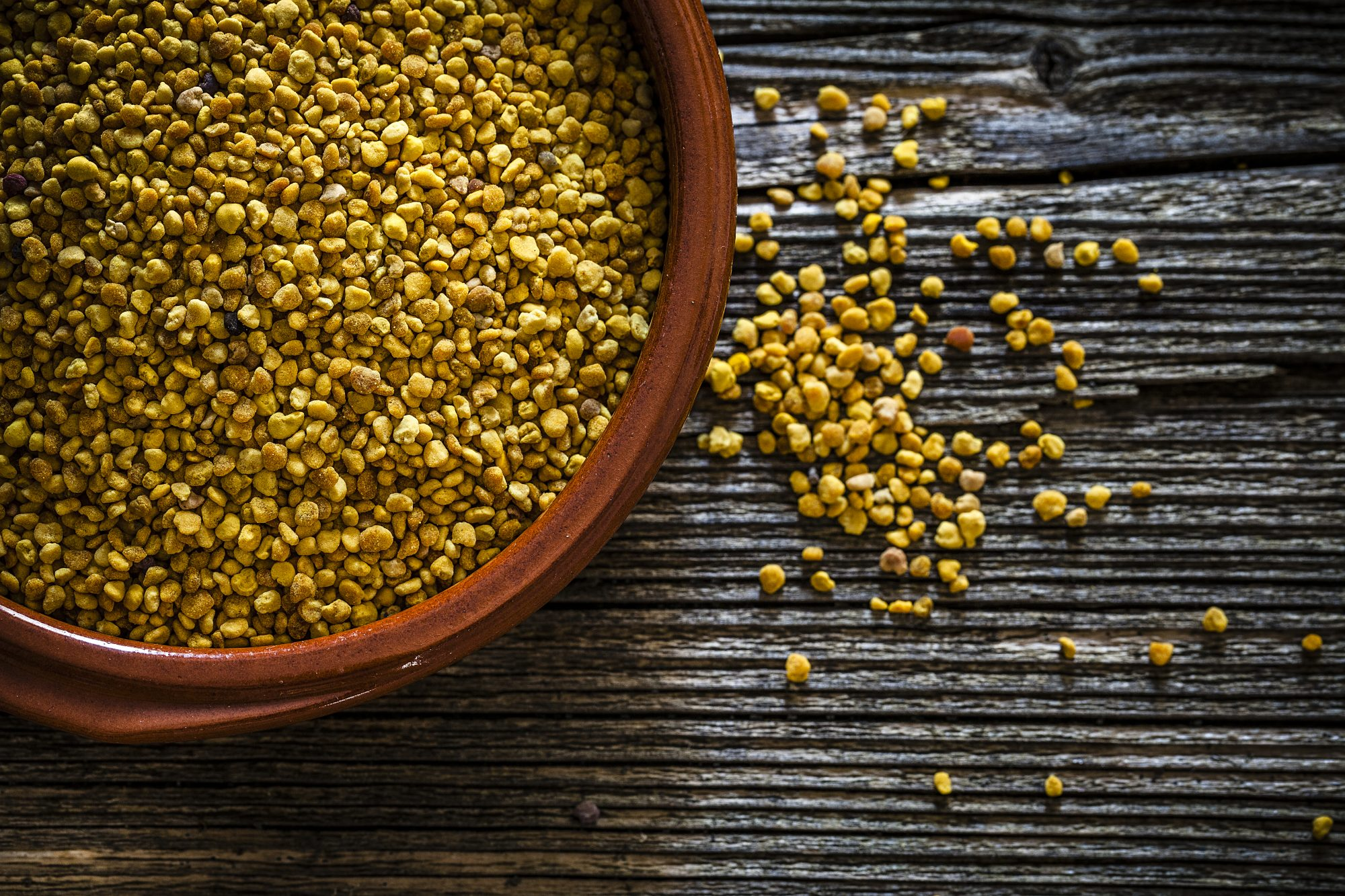 bee pollen in clay bowl
