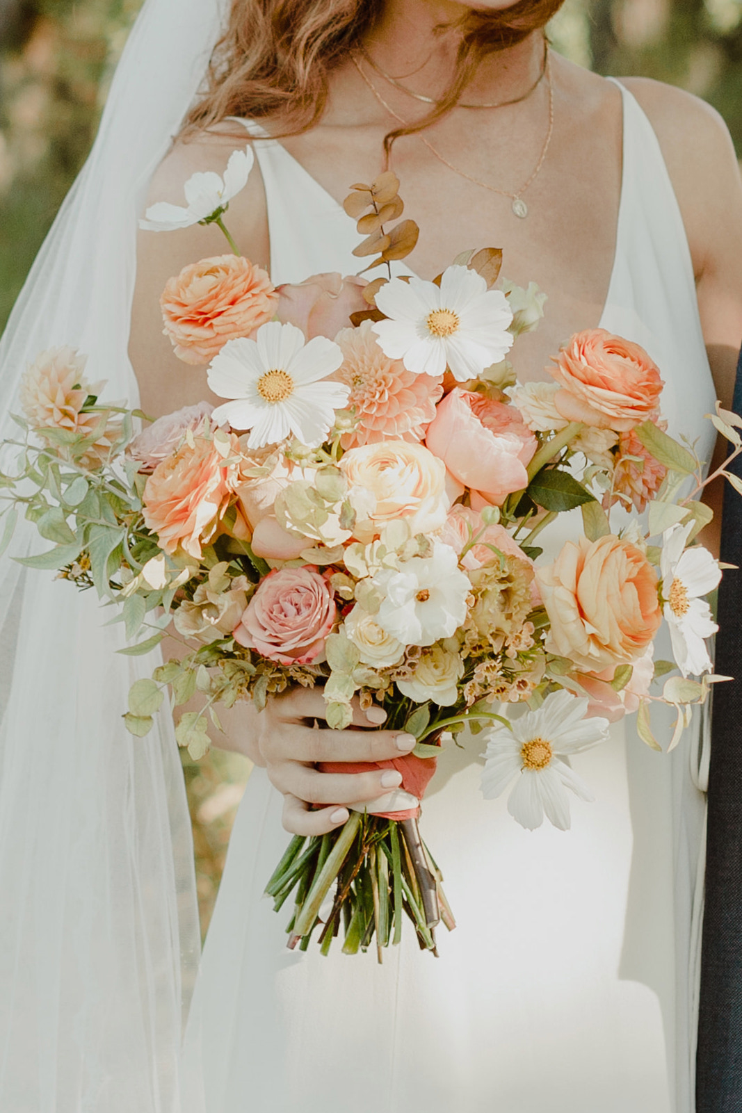 peach and white color wedding floral bouquet