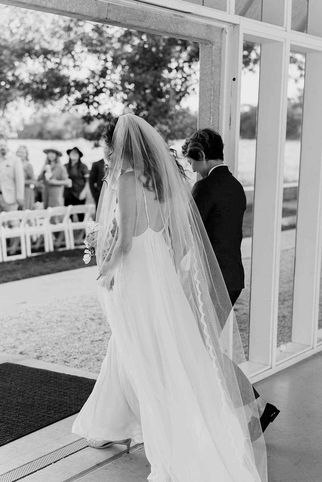 brides walking down processional aisle together
