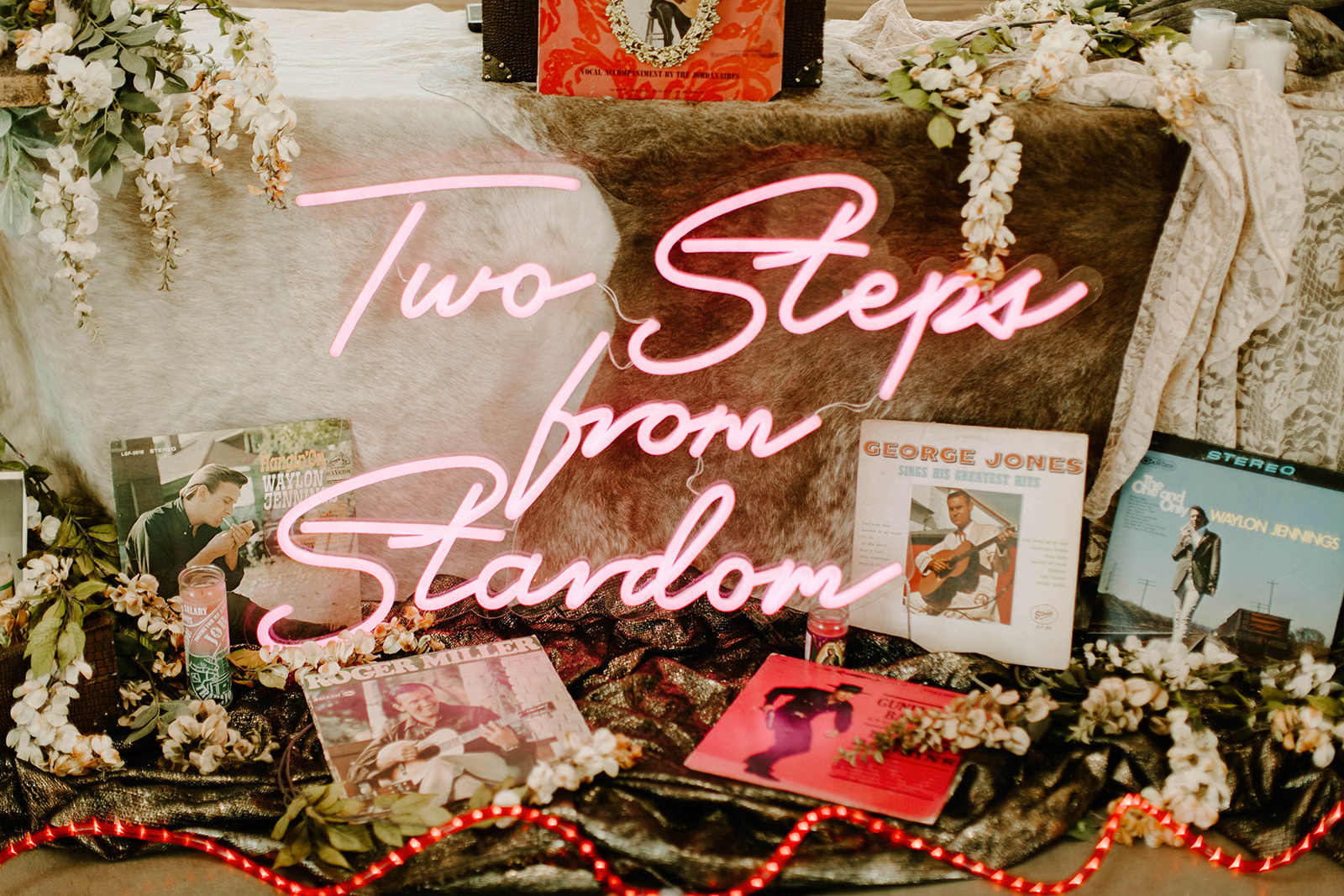 two steps from stardom neon pink sign