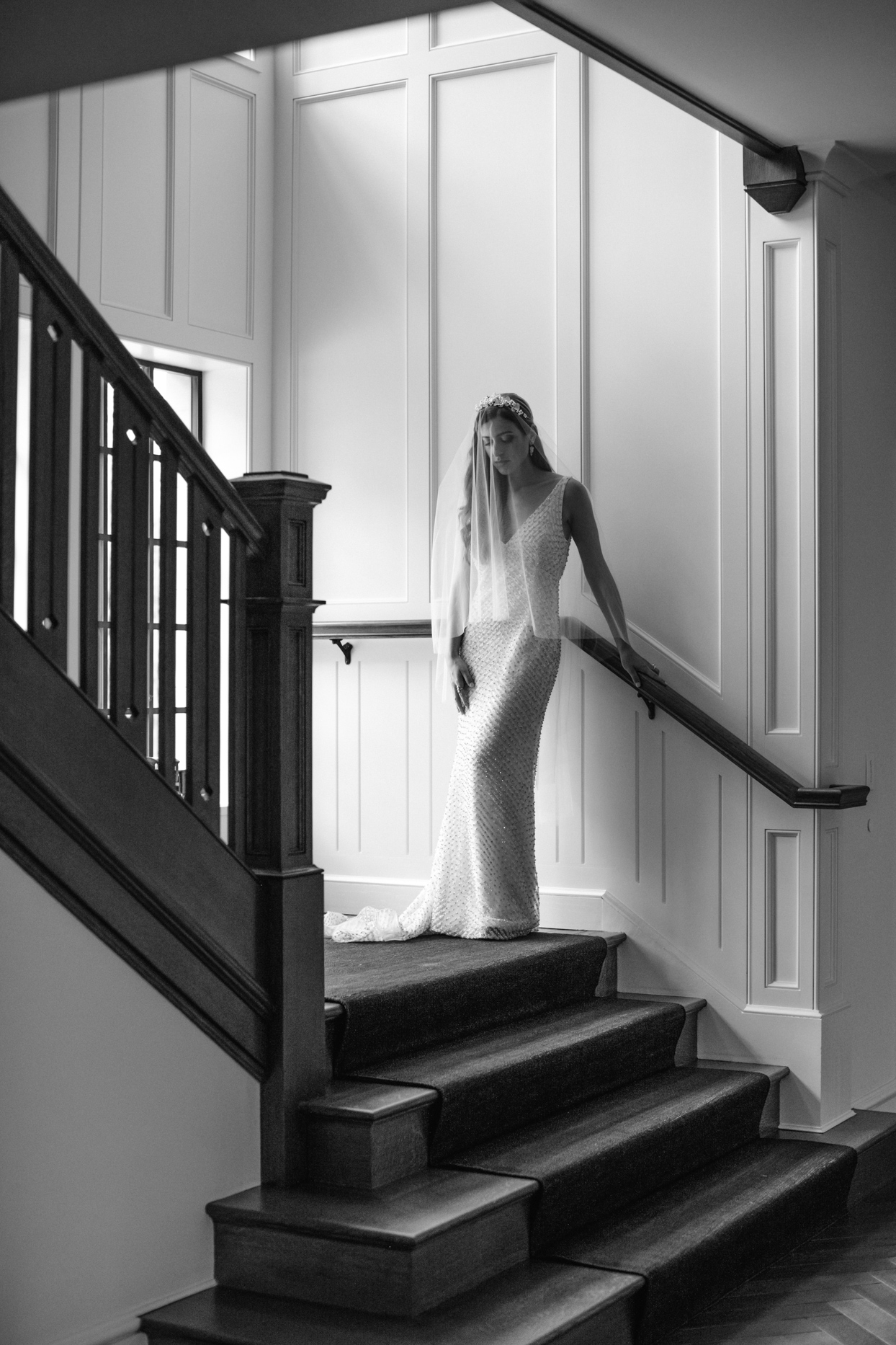 bride standing in artistic pose on stairway