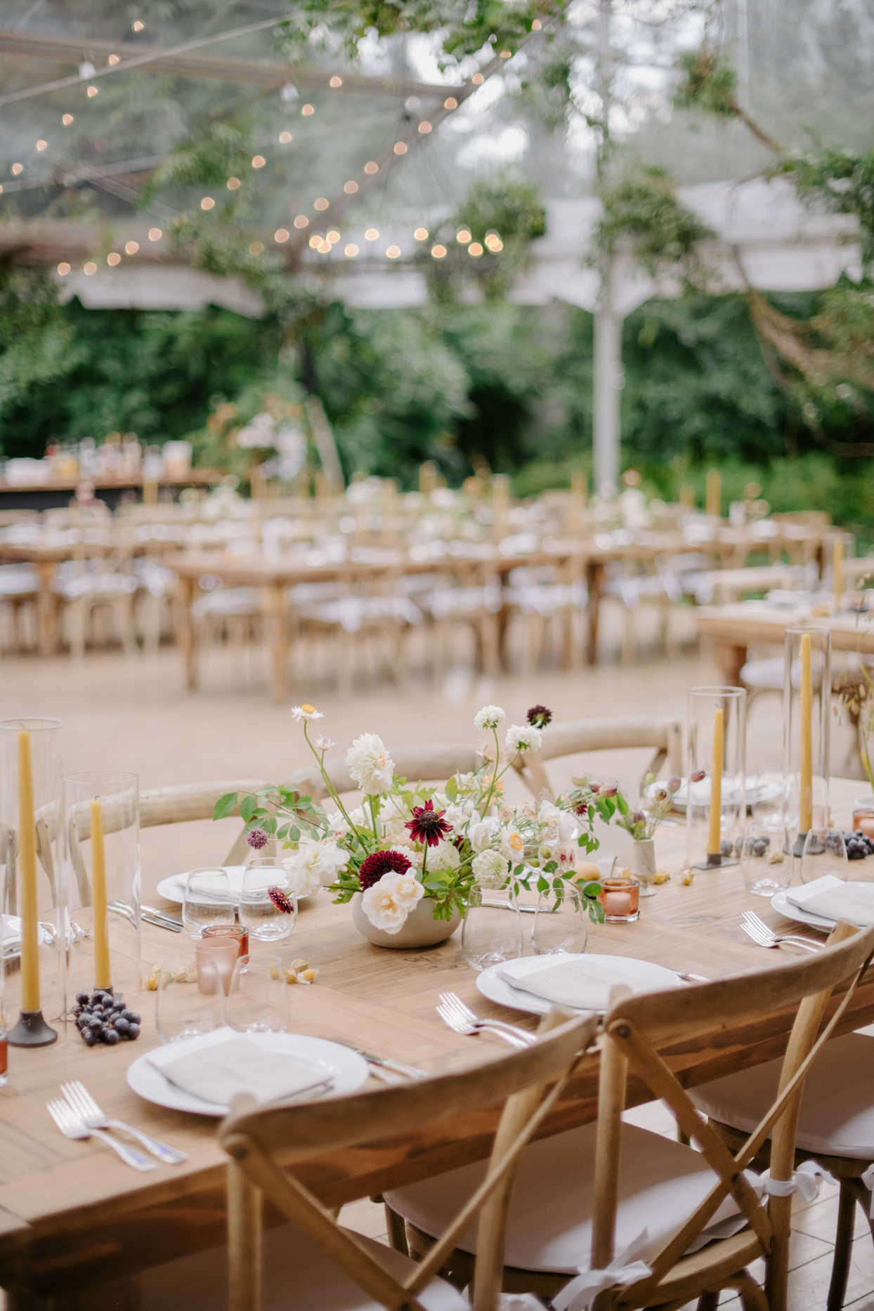 elegant wooden outdoor tables with wildflower centerpieces