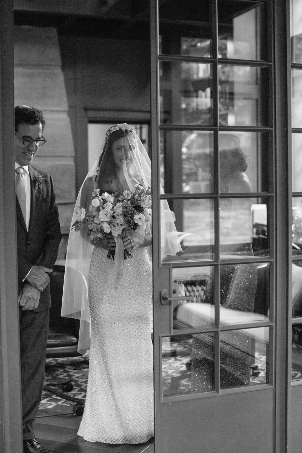 bride and parents preparing to enter ceremony through french doors