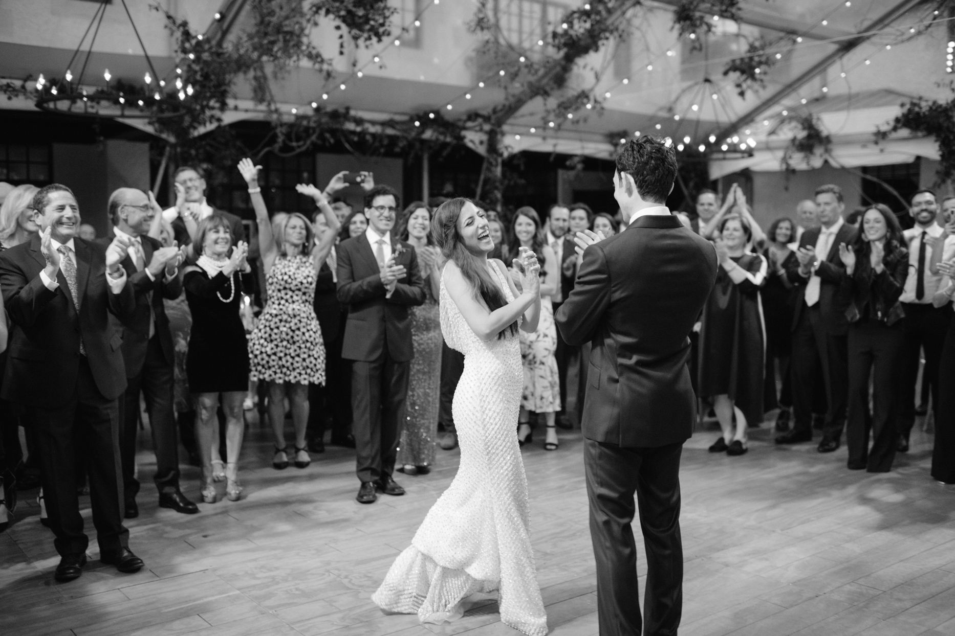 wedding couple laughing together on dance floor