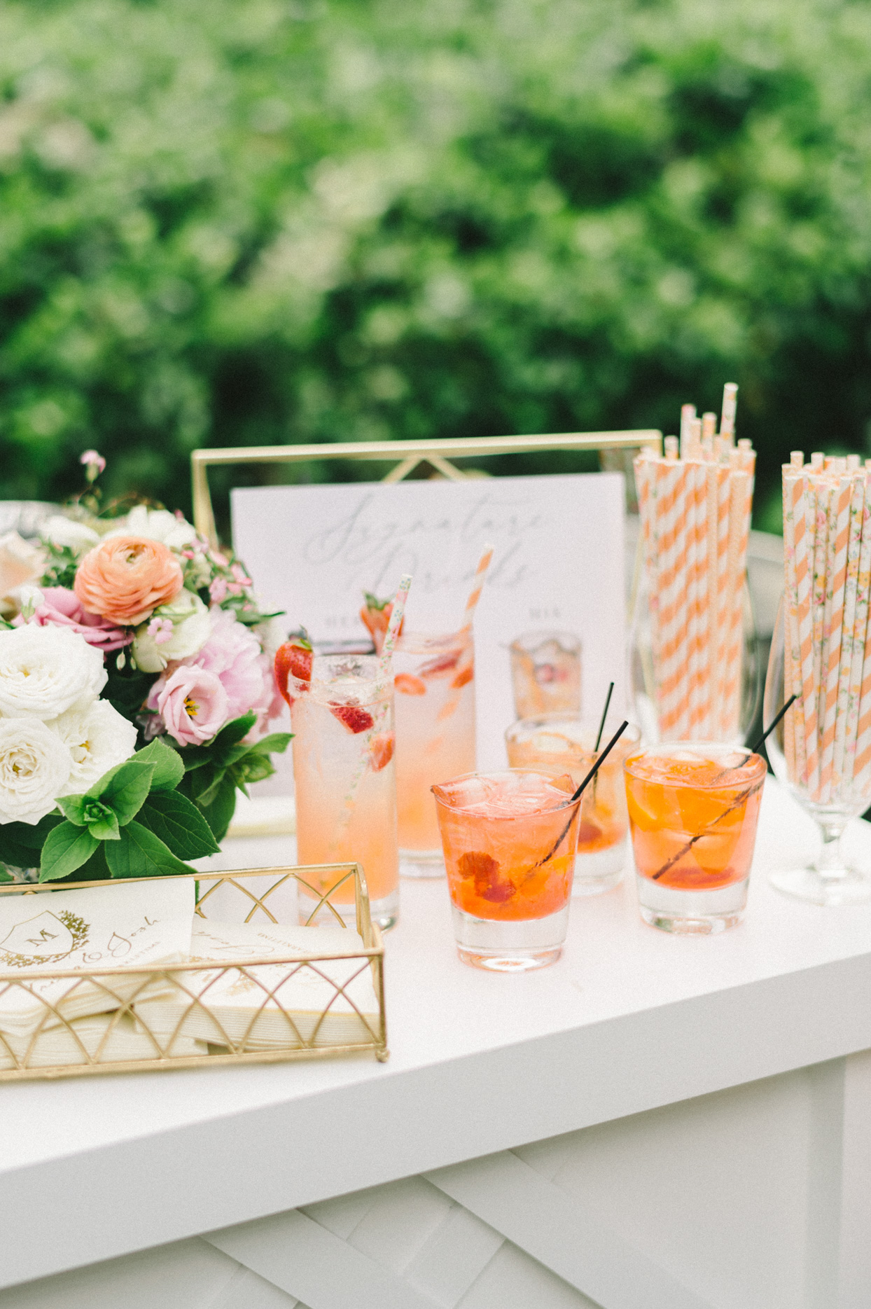 peach colored cocktails on wedding bar